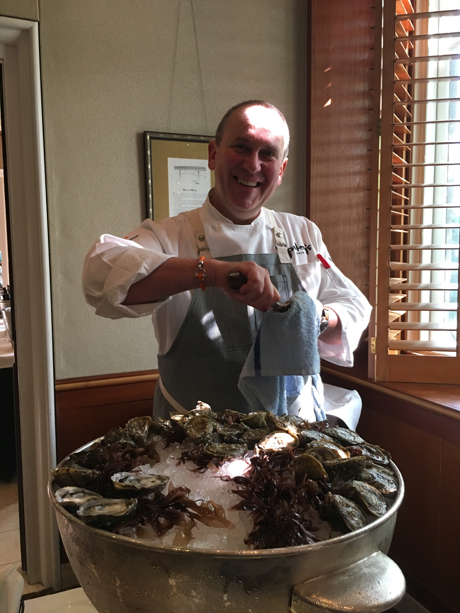 Vitaly Paley shucking oysters prior to the pFriem Beer Dinner at Headwaters. (photo by Cat Stelzer)