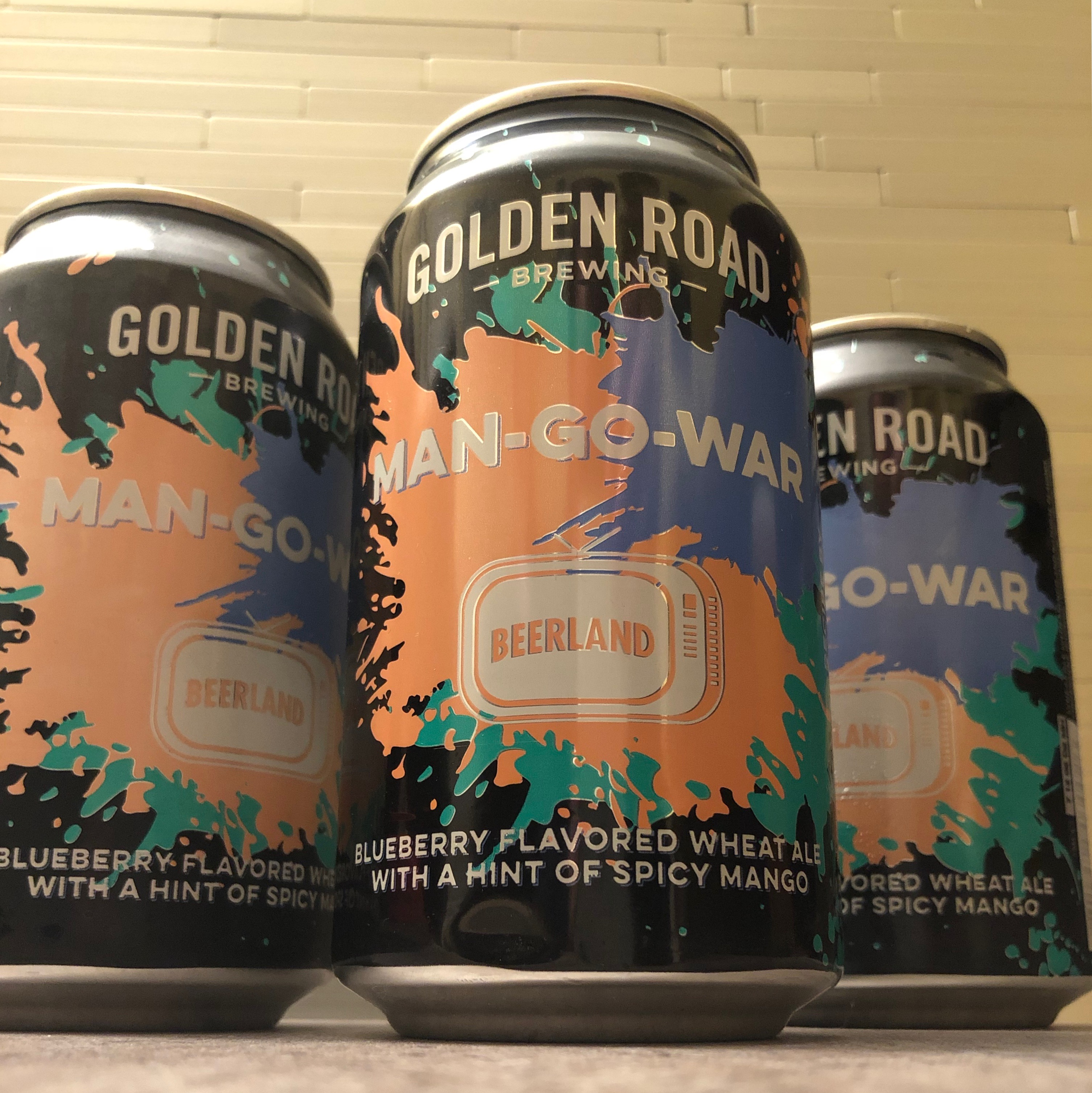 Cans of Golden Road Brewing Man-Go-War Wheat Ale brewed in collaboration with Michael Flinn & Jonathan Billings, winners of BEERLAND Season Two.