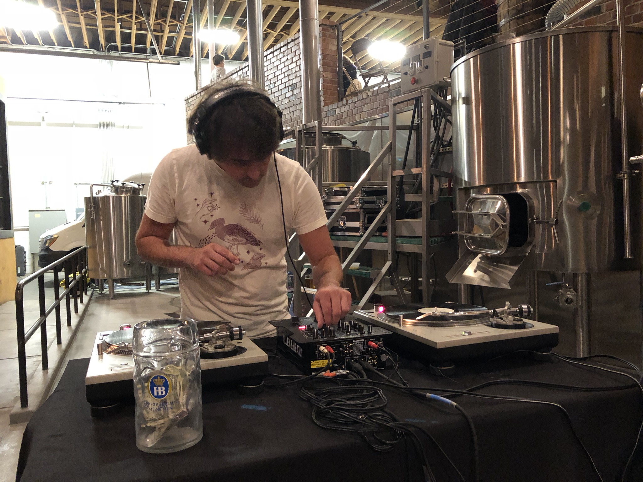 Travis working the turntable at The Commons last day. (photo by Cat Stelzer
