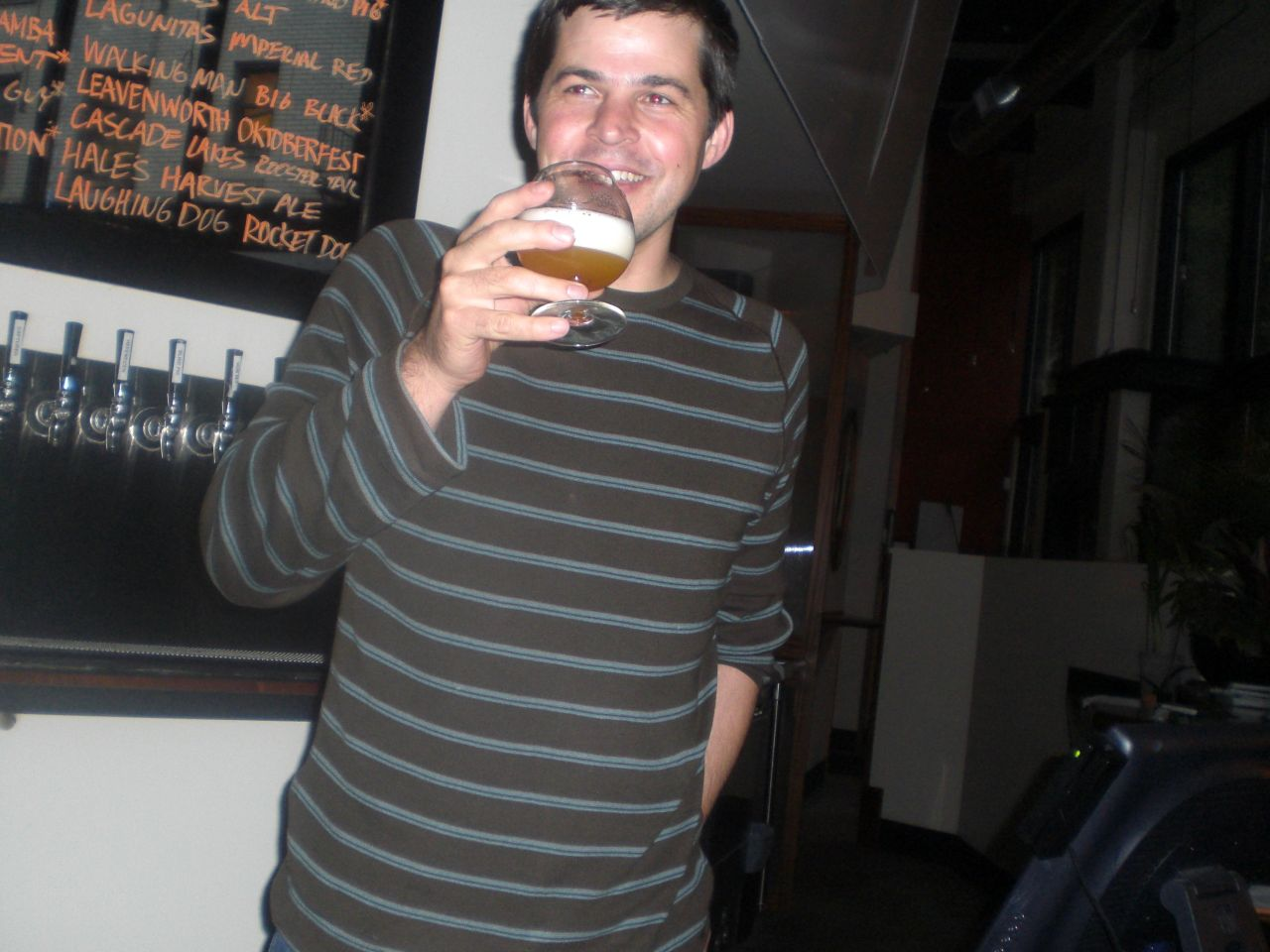 Geoff Phillips drinking a beer after closing time at Bailey's Taproom in September 2008. (photo by Angelo De Ieso)