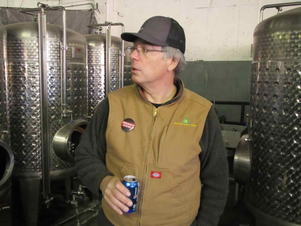 Larry Sidor giving us a tour of his brewhouse that was in storage while attending the 2012 Zwickelmania in Bend, Oregon. A few months later this brewhouse would be installed at the soon to be opened Crux Fermentation Project. (photo by Angelo De Ieso)