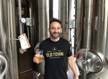 Adam Milne from Old Town Brewing at his brewery in Northeast Portland. He continues his trademark fight with the City of Portland. The city wants to market Old Town's trademarked Stag Logo to other alcohol producers. Shame on you Portland.