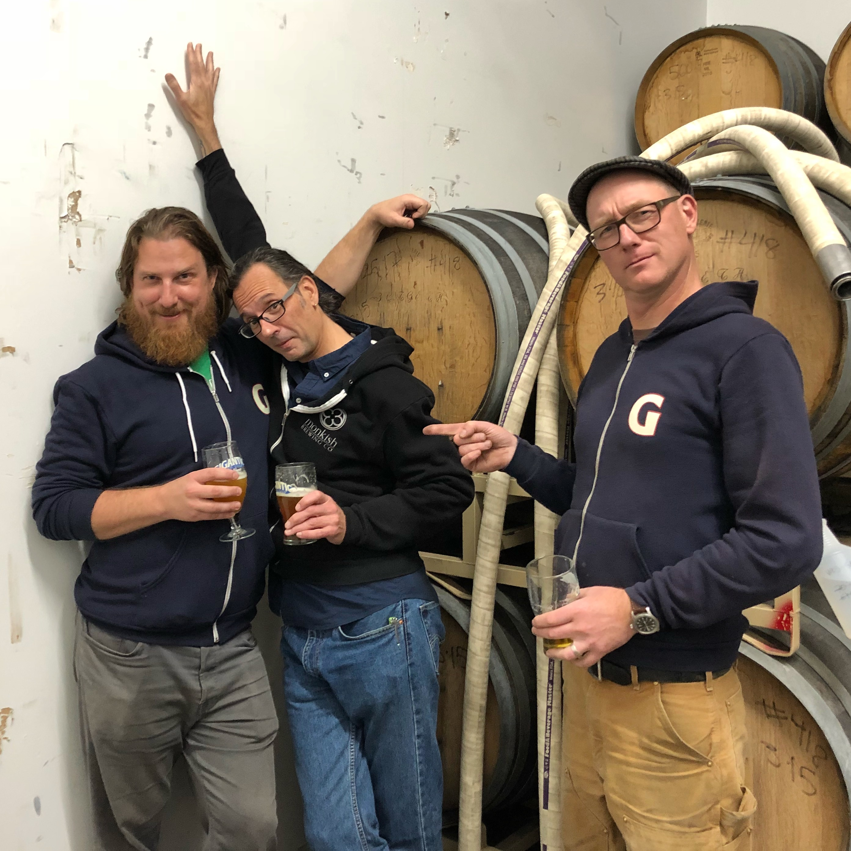 Ben Love and Van Havig of Gigantic Brewing surround Ron Jeffries from Jolly Pumpkin.