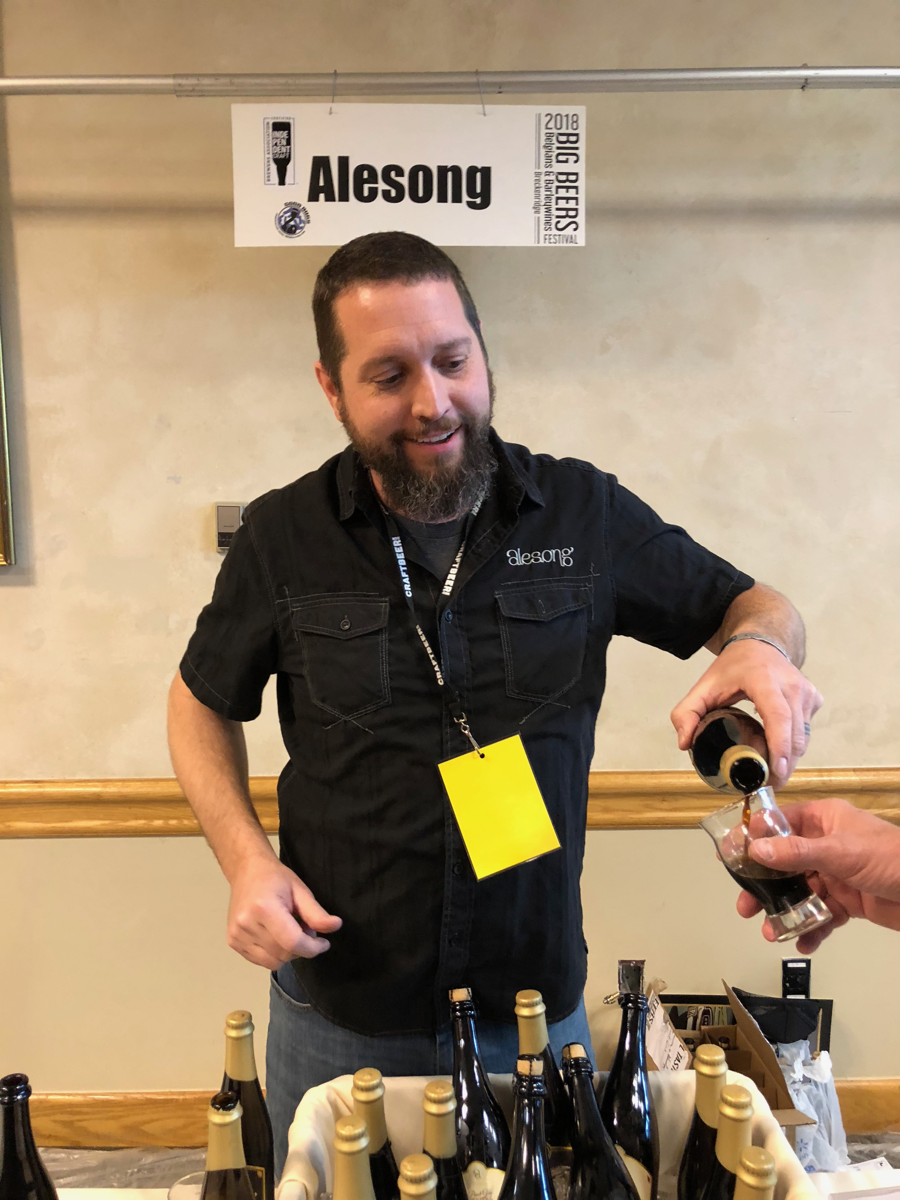 Matt Van Wyk from Alesong Brewing & Blending pouring a sneak peek of Four Pirates in Breckenridge, Colorado during the 2018 Big Beers, Belgians and Barleywine Festival.