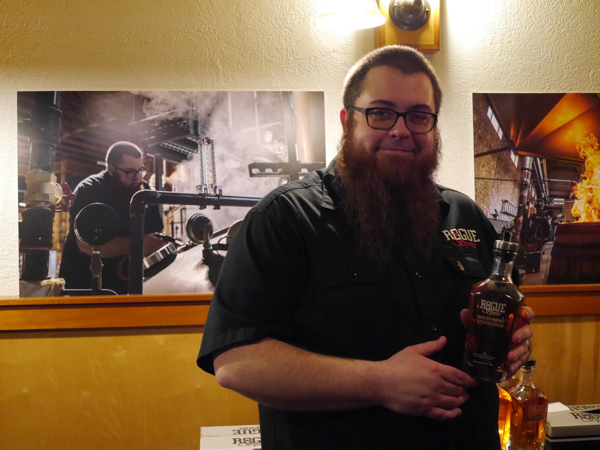 Rogue Spirits Master Distiller Jake Holshue at a recent tasting. (photo by Cat Stelzer)