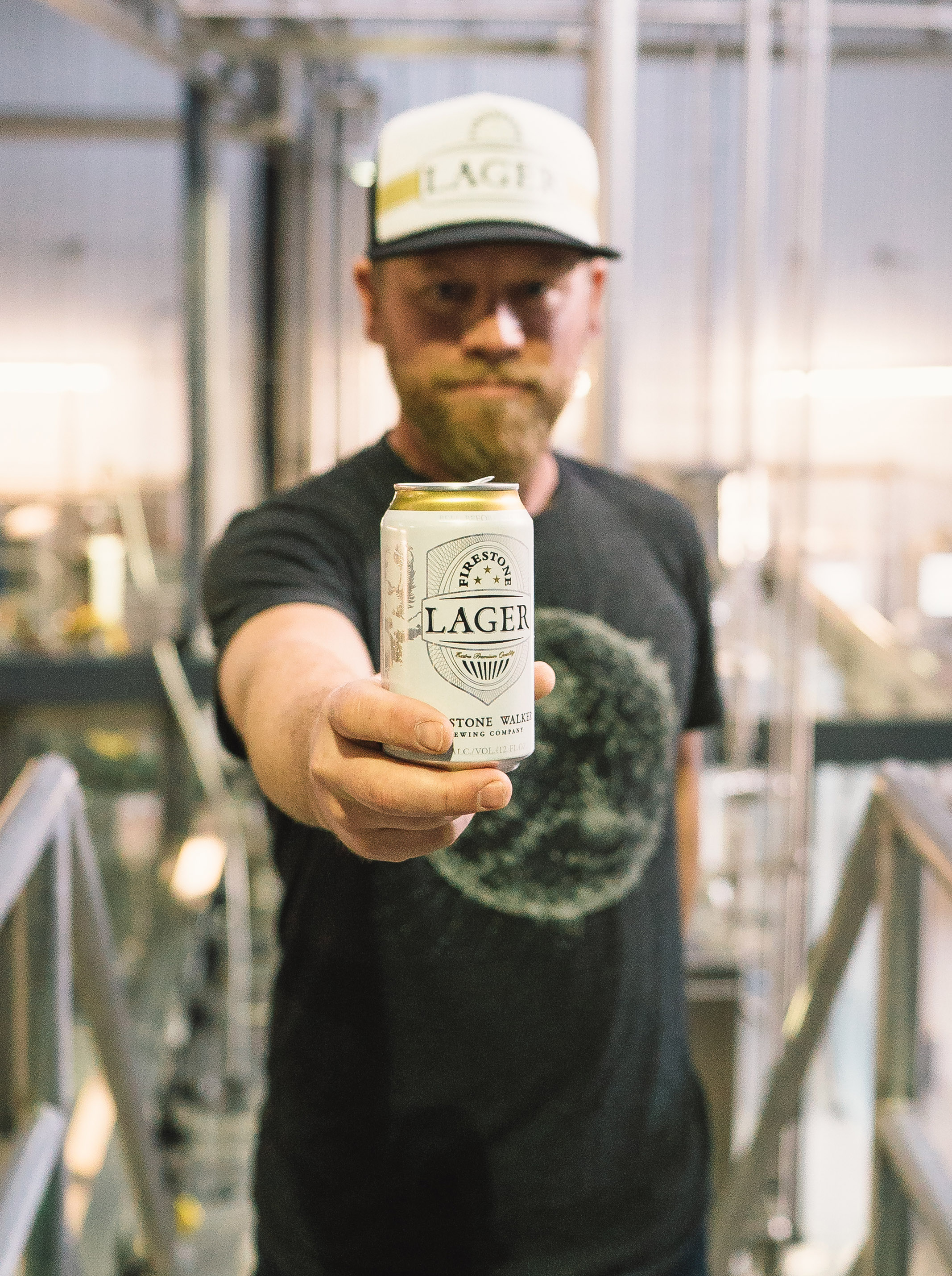 image of Matt Brynildson holding a can of Firestone Lager courtesy of Firestone Walker Brewing