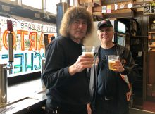 Terry Currier, owner of Music Millennium and Carl Singmaster at the new beer bar inside Music Millennium.