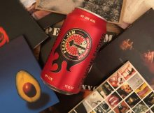 A collage of Pearl Jam CDs with a can of Georgetown Brewing The Home Shows Seattle Pale Ale. This beer is brewed in conjunction with Pearl Jam and its Vitalogy Foundation.