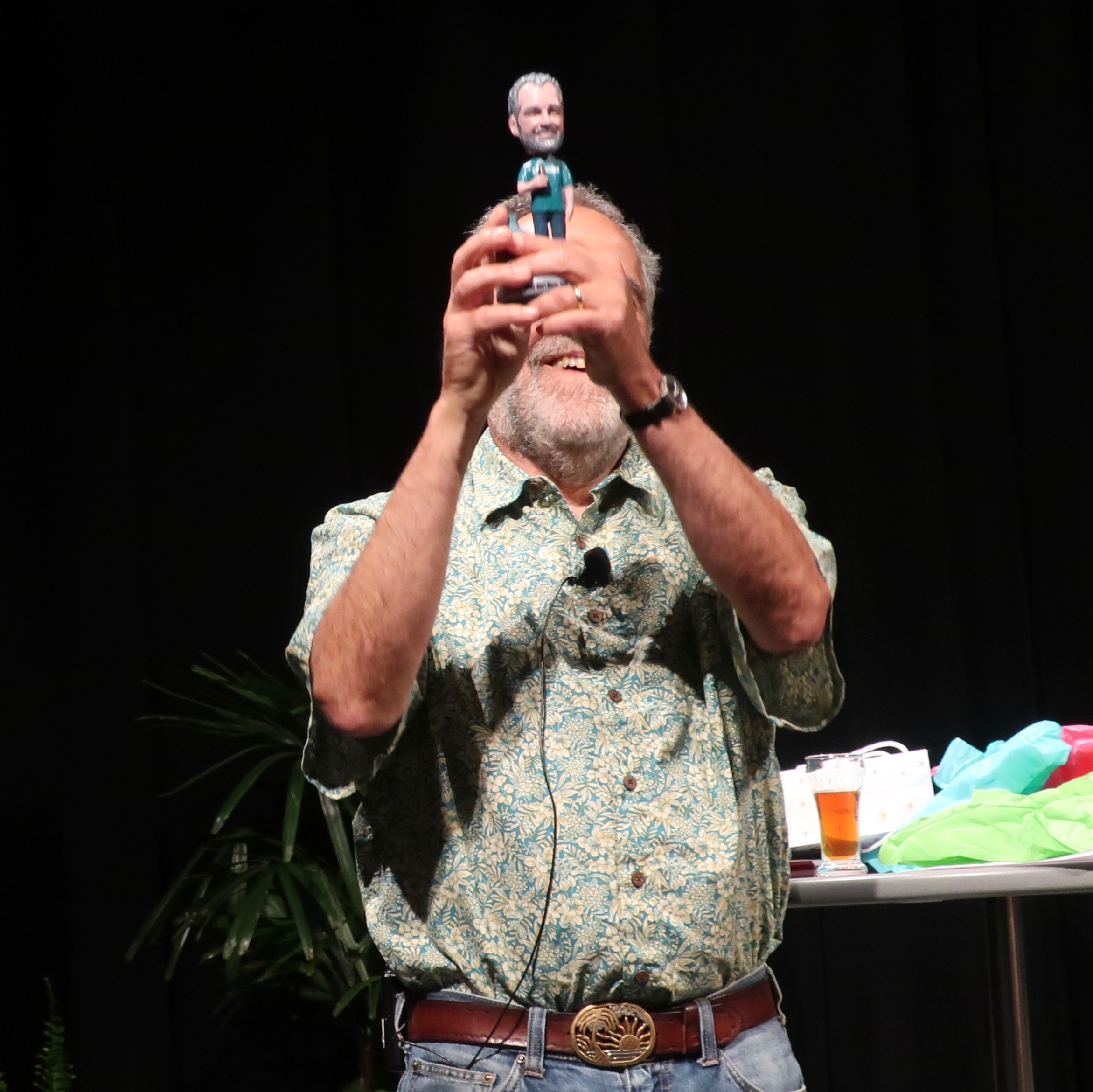 Charlie Papazian holds up his bobblehead that he received as a partying gift during the Keynote Address at Homebrew Con 2018.