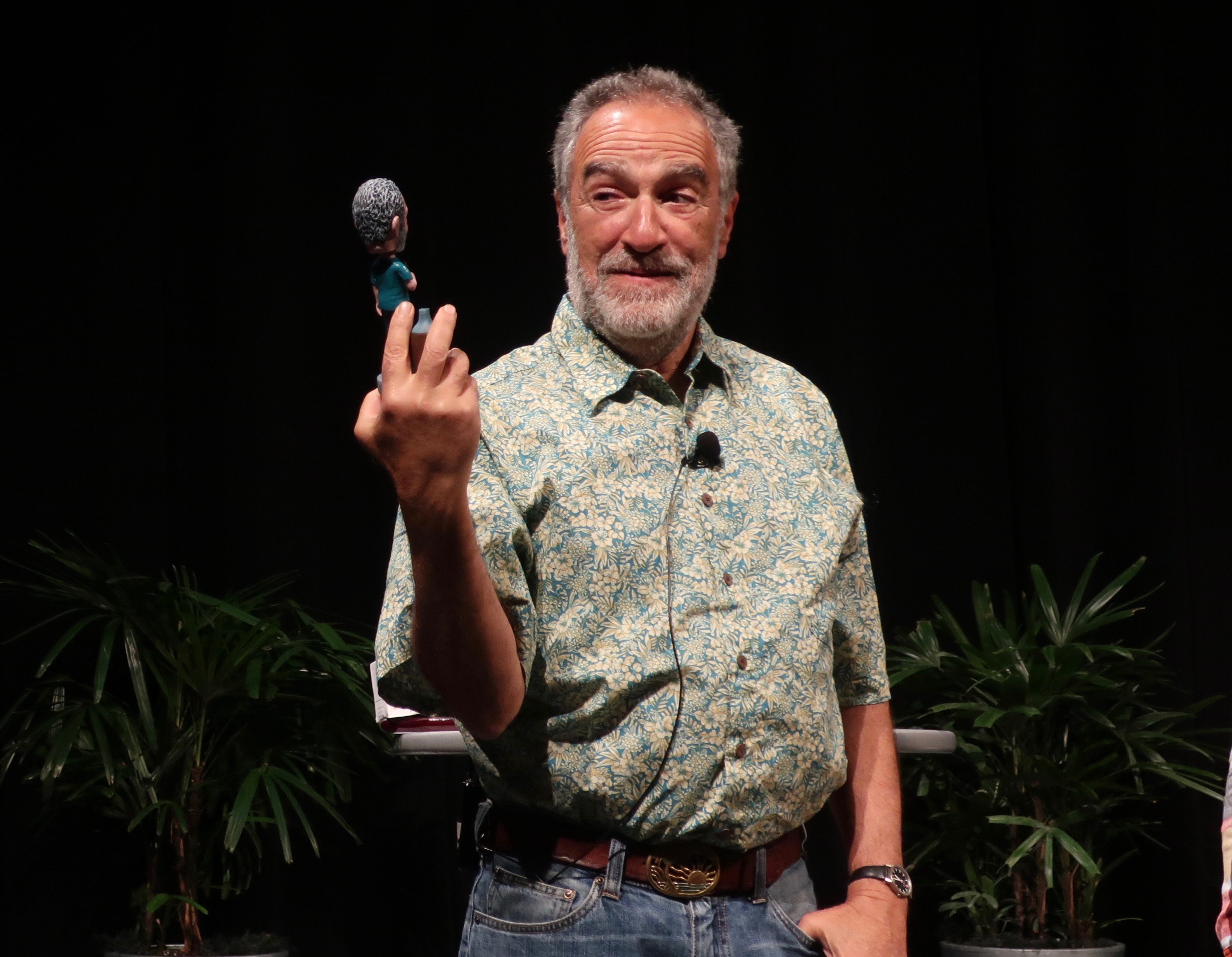 Charlie Papazian inspects his bobblehead during the Keynote Address at Homebrew Con 2018.