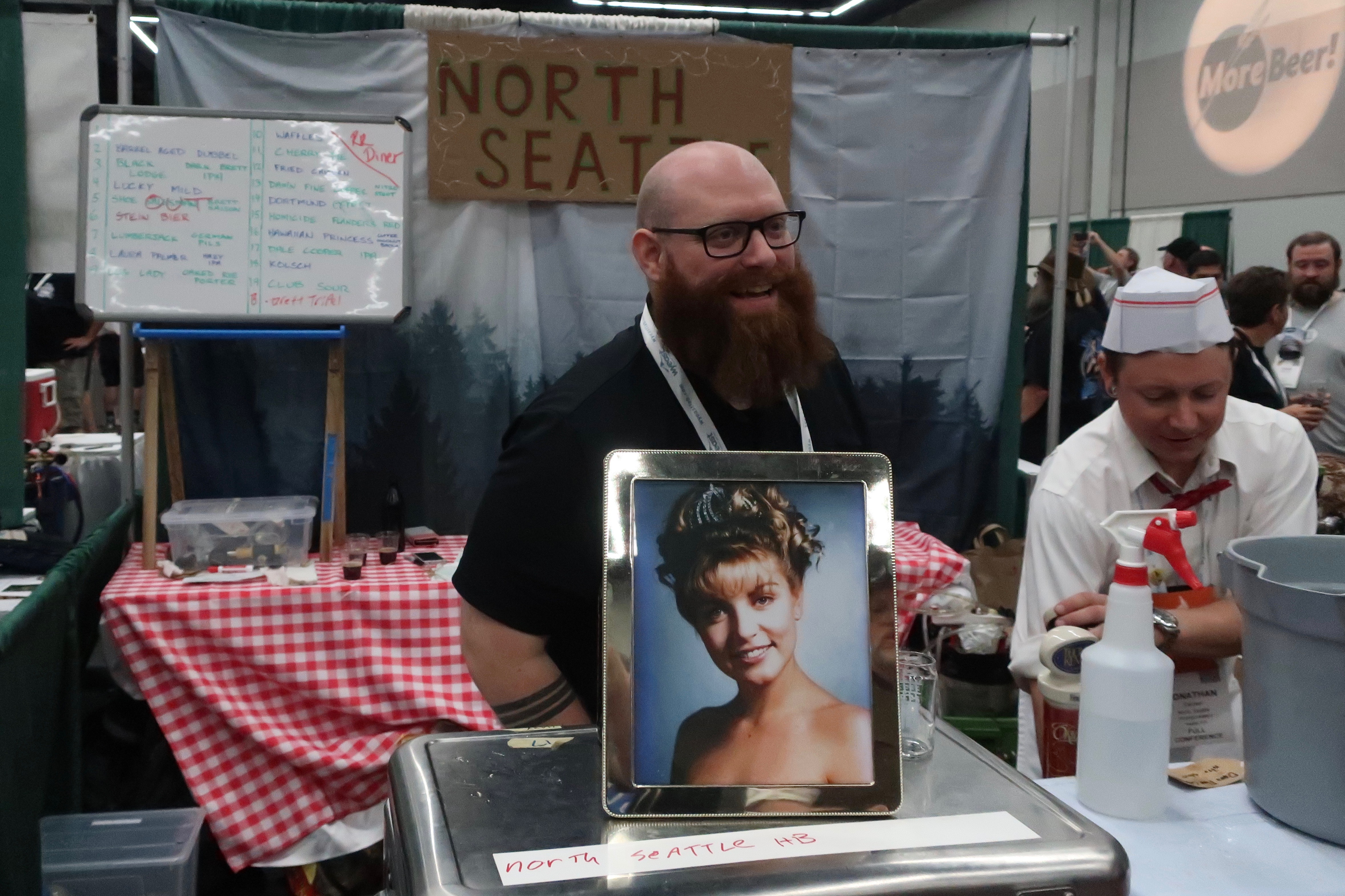 North Seattle Homebrew Club with its Twin Peaks themed booth during Club Night at Homebrew Con 2018.