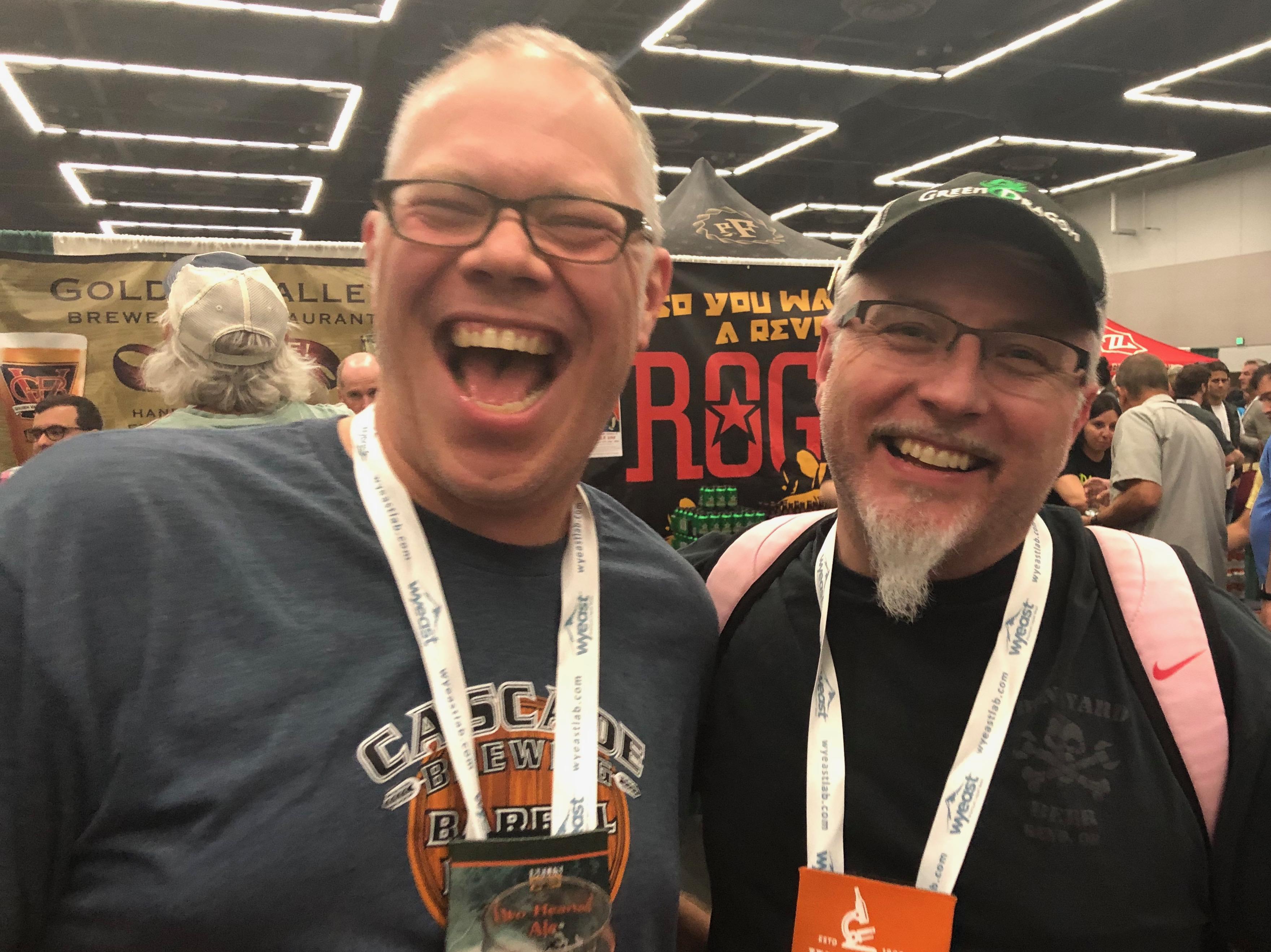 Rodney Kibzey and Dylan VanDetta laughing during the Homebrew Con 2018 Kickoff Party.