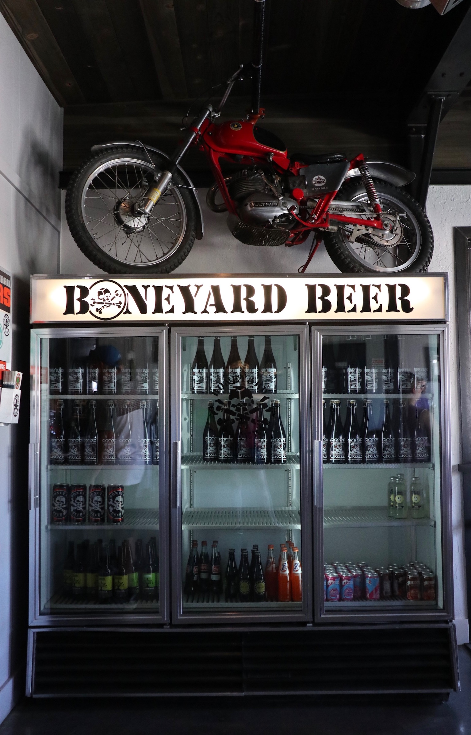 A motorbike atop the beer cooler at the new Boneyard Pub. (photo by Cat Stelzer)