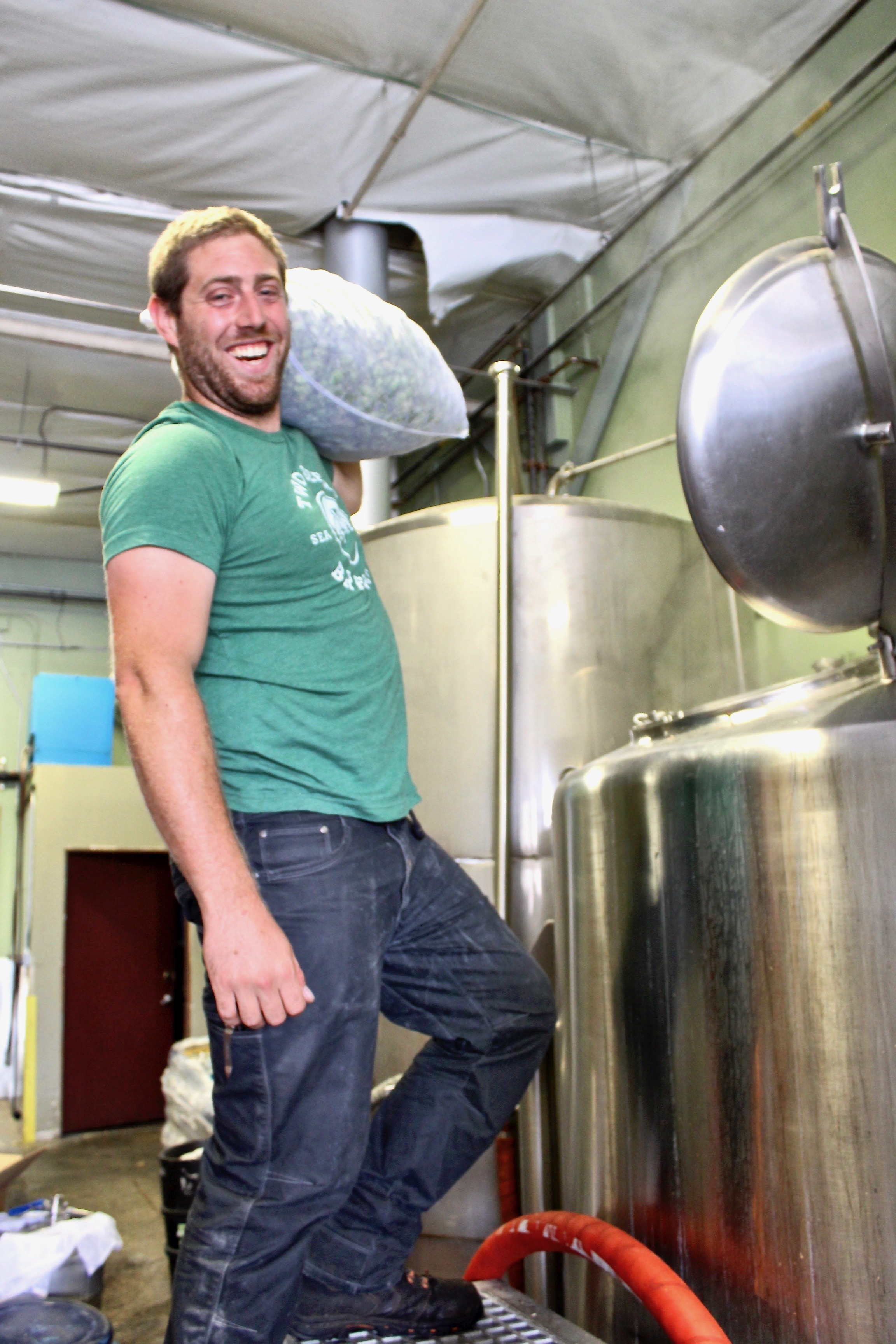 Two Beers Brewing's Head Brewer, Jesse Ransavage, adding the Fresh Hops. (image courtesy of Two Beers Brewing Co.)