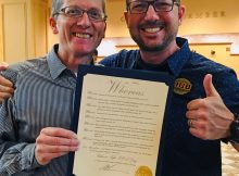 Dan Kent, Salmon-Safe co-founder and executive director, and Hopworks founder Christian Ettinger with the official proclamation naming Saturday August 25 as Salmon-Safe Day in Portland. (image courtesy of Hopworks Urban Brewery and Salmon-Safe)
