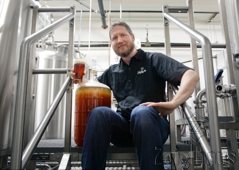 image of Alan Taylor with a carboy of wort from the Zoigl-Wort Share courtesy of Zoiglhaus Brewing