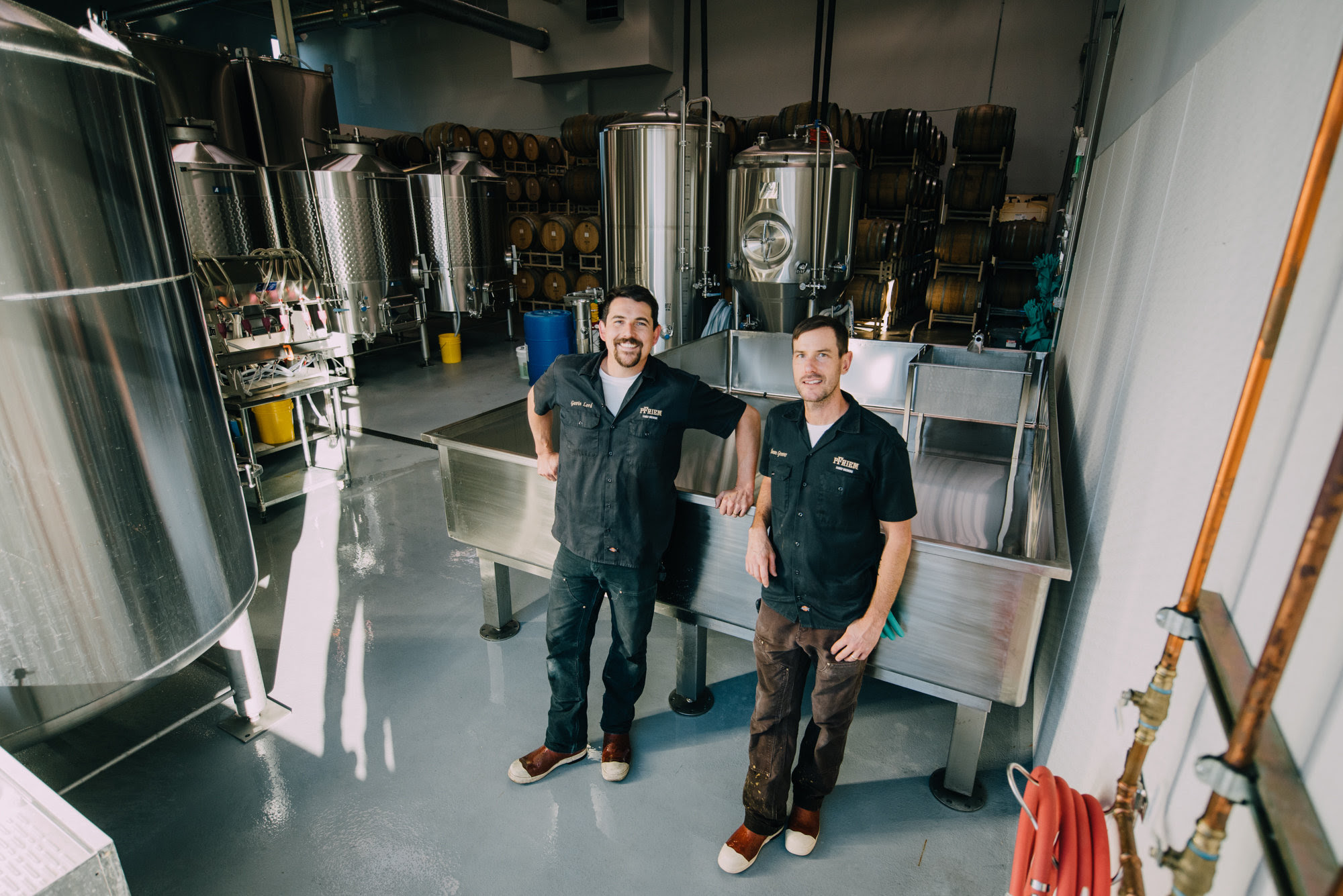 Gavin Lord and Sean Grover pose in front of pFriem's new coolship. (image courtesy of pFriem Family Brewers)