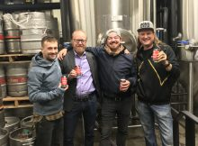Matthew Jarrell, Director of Culinary Operations at Paley Hospitality, Garrett Peck, Director of Operations at Paley Hospitality and Erick Russ and Larry Clouser, Co-Owners of Pono Brewing during brew day for Bushel & A Peck IPA.