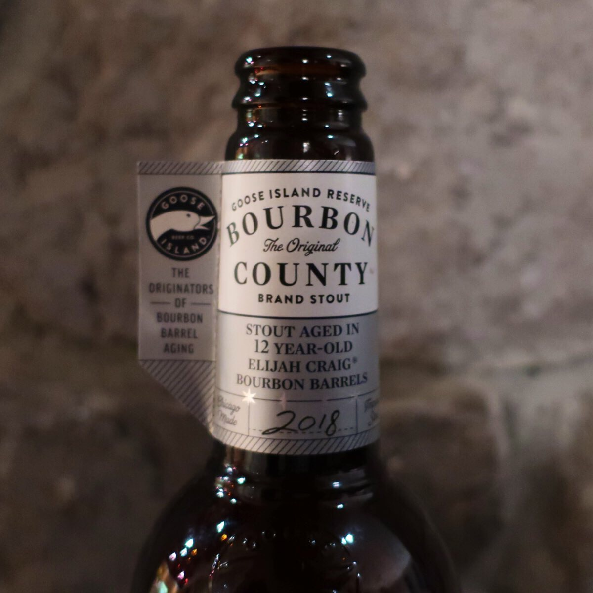The front of the neck label for Goose Island 2018 Reserve Bourbon County Brand Stout.