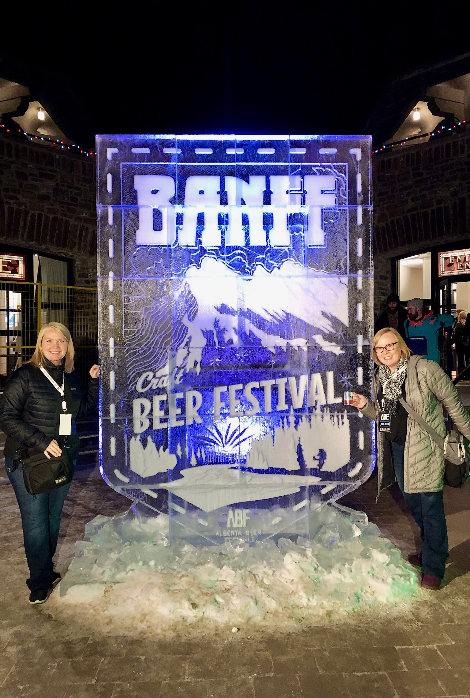 Sarah & Catherine with the Ice Sculpture in the outdoor area at the Banff Craft Beer Festival.