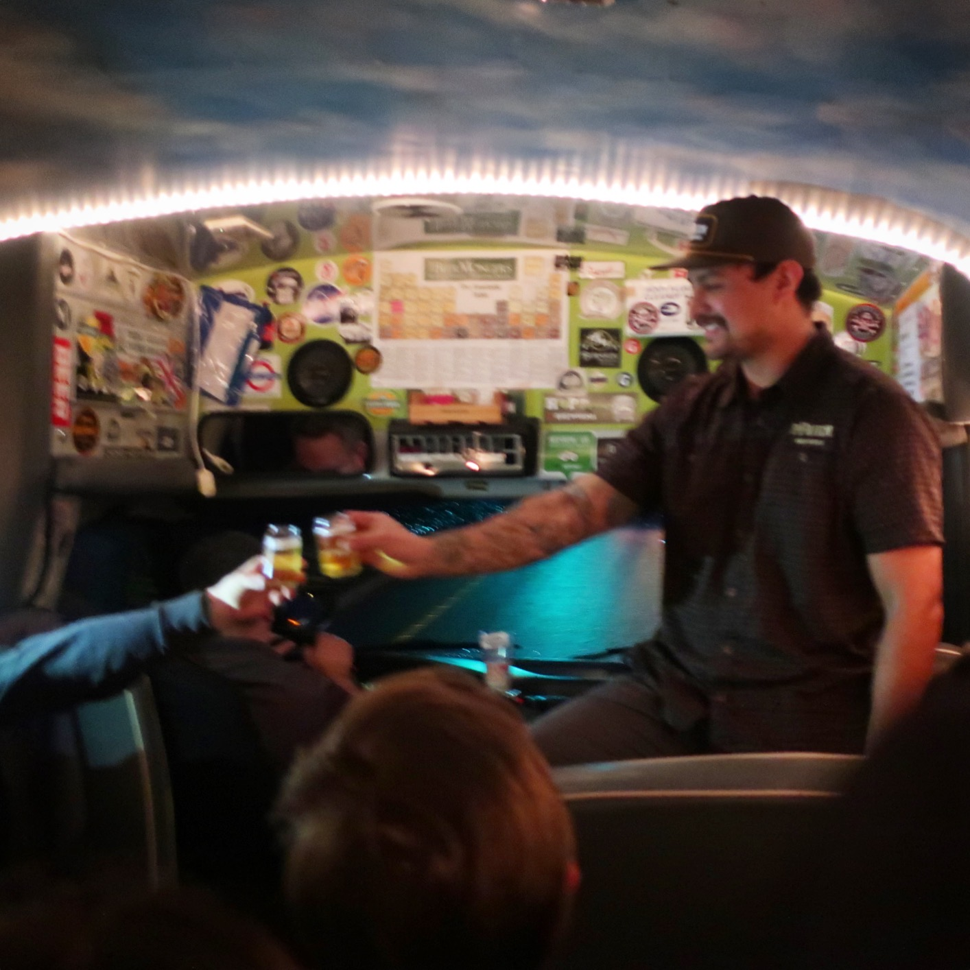 Justin Walker from pFriem pouring beers on the Brewvana bus on the way to the brewery in Hood River, Oregon.