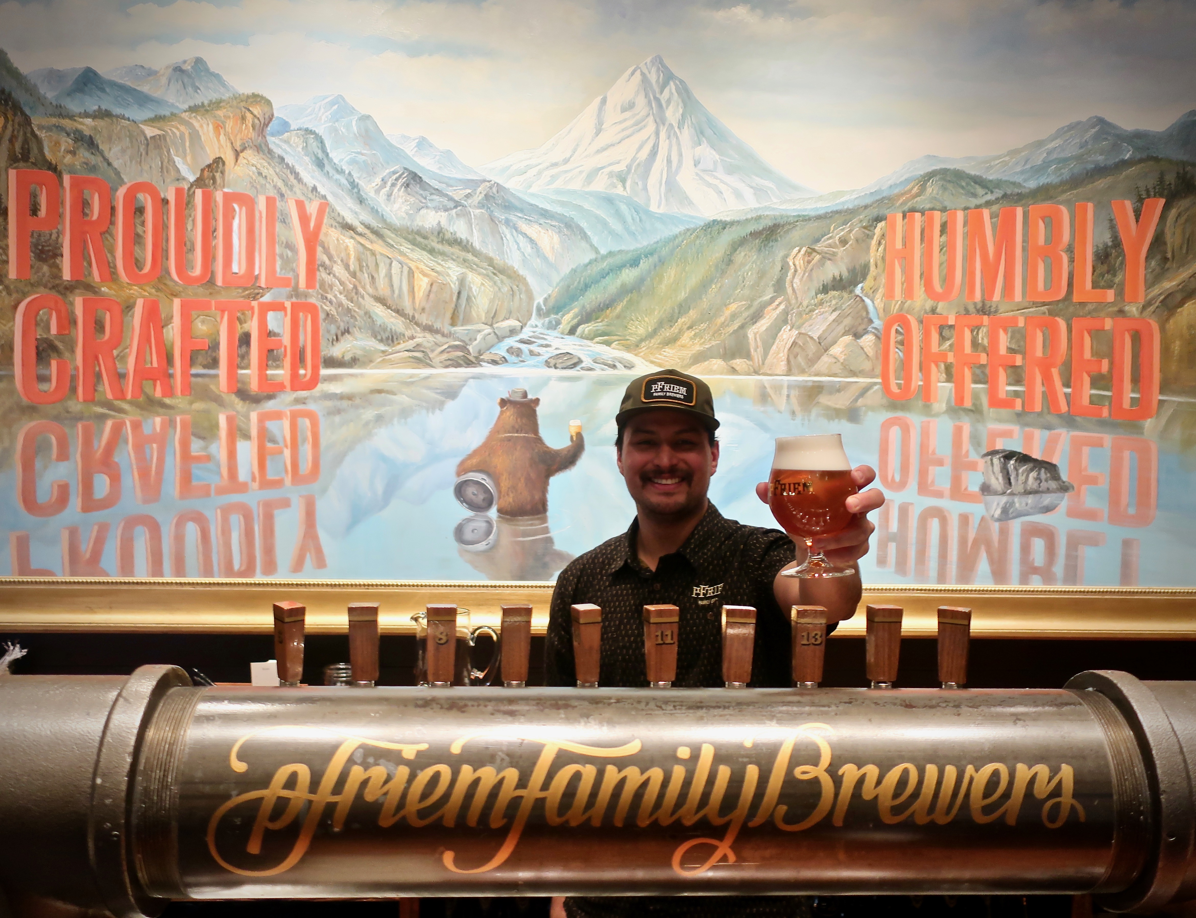 Justin Walker pours a pint of Rauch Helles at pFriem Family Brewers.