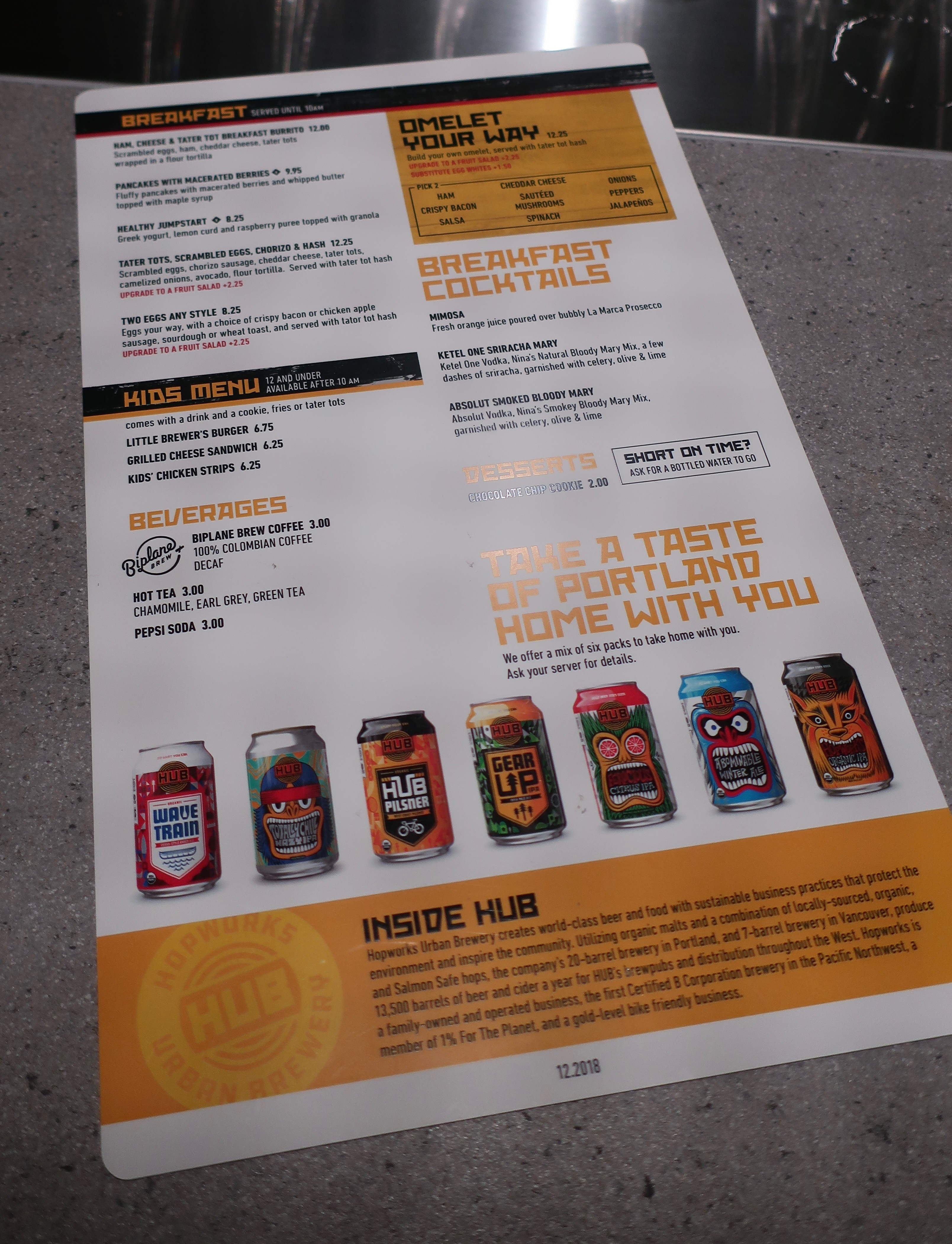 Page 1 of the menuat at Hopworks Urban Brewery in Concourse E at the Portland International Airport.