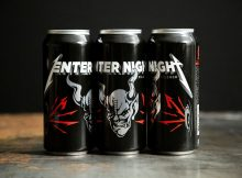 Three cans Enter Night Pilsner from Arrogant Consortia. (image courtesy of Stone Brewing)