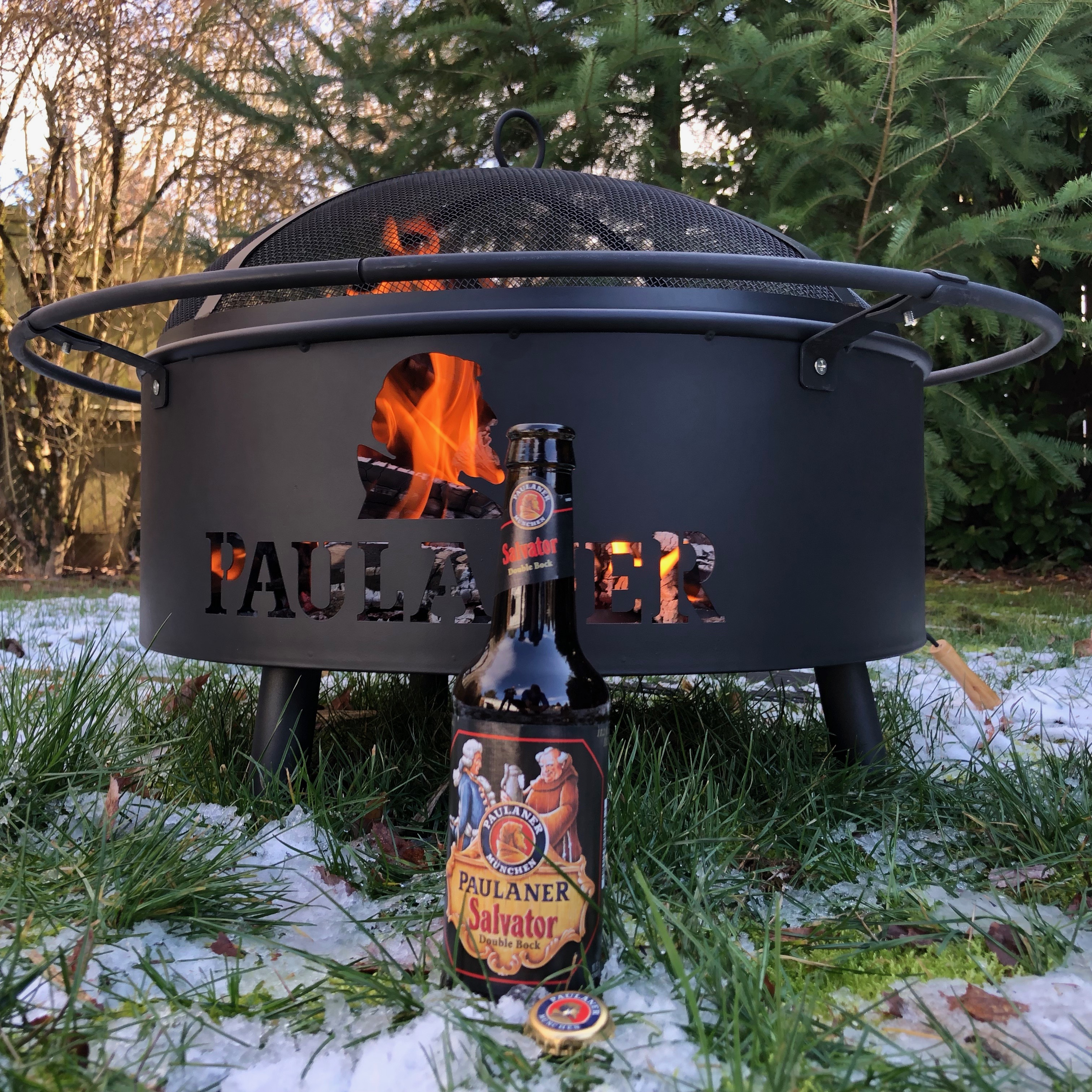 A bottle of Paulaner Salvator Double Bock and a Paulaner Fire Pit.