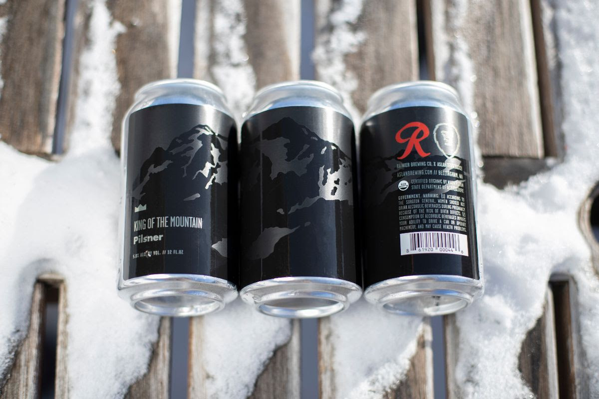 A six-pack of Aslan Brewing Co. and Rainier Brewing Co. King of the Mountain Pilsner. (image courtesy of Aslan Brewing)