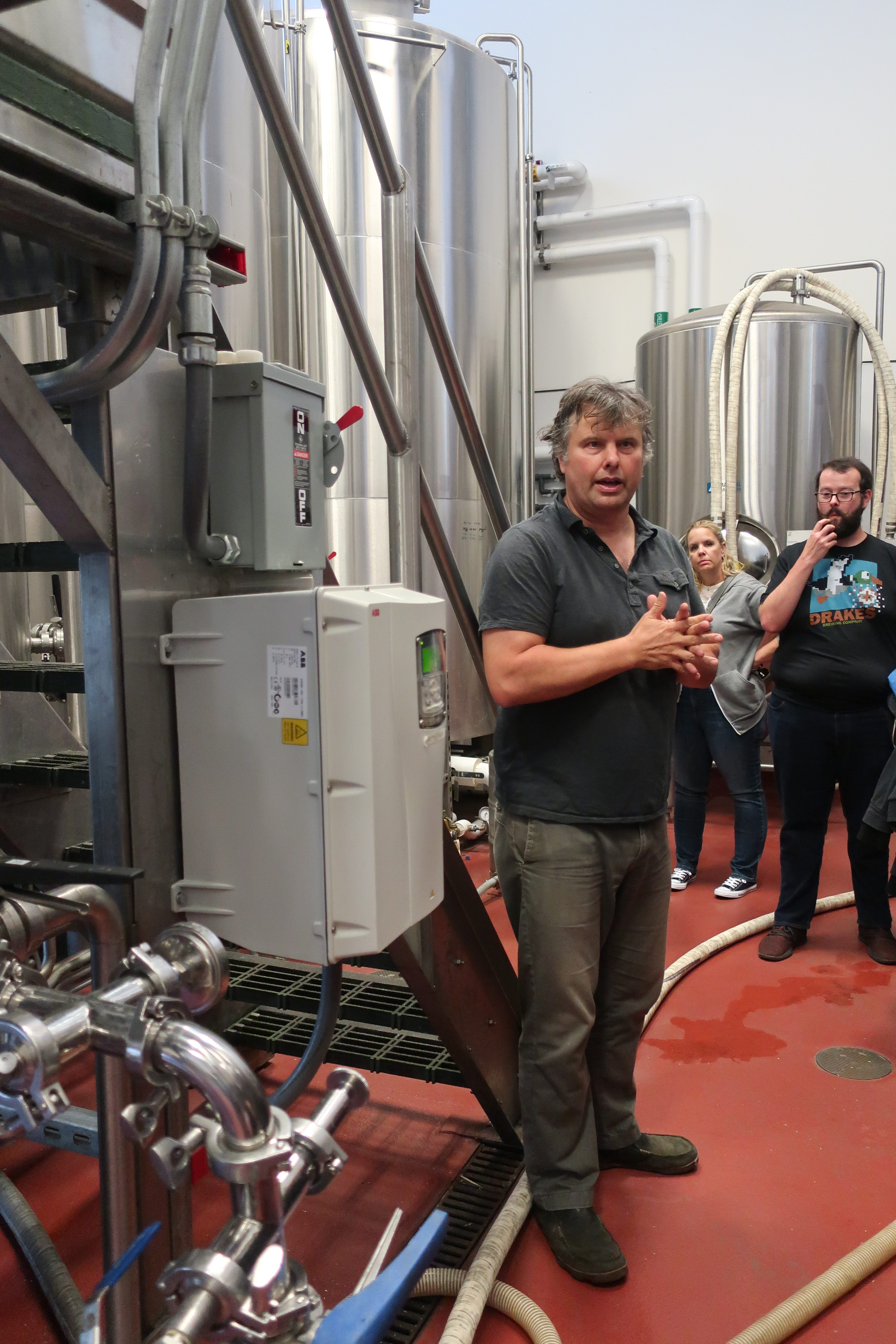 Christian Krogstad, founder of House Spirits giving a tour while discussing the brewing process to make Westward Whiskey.