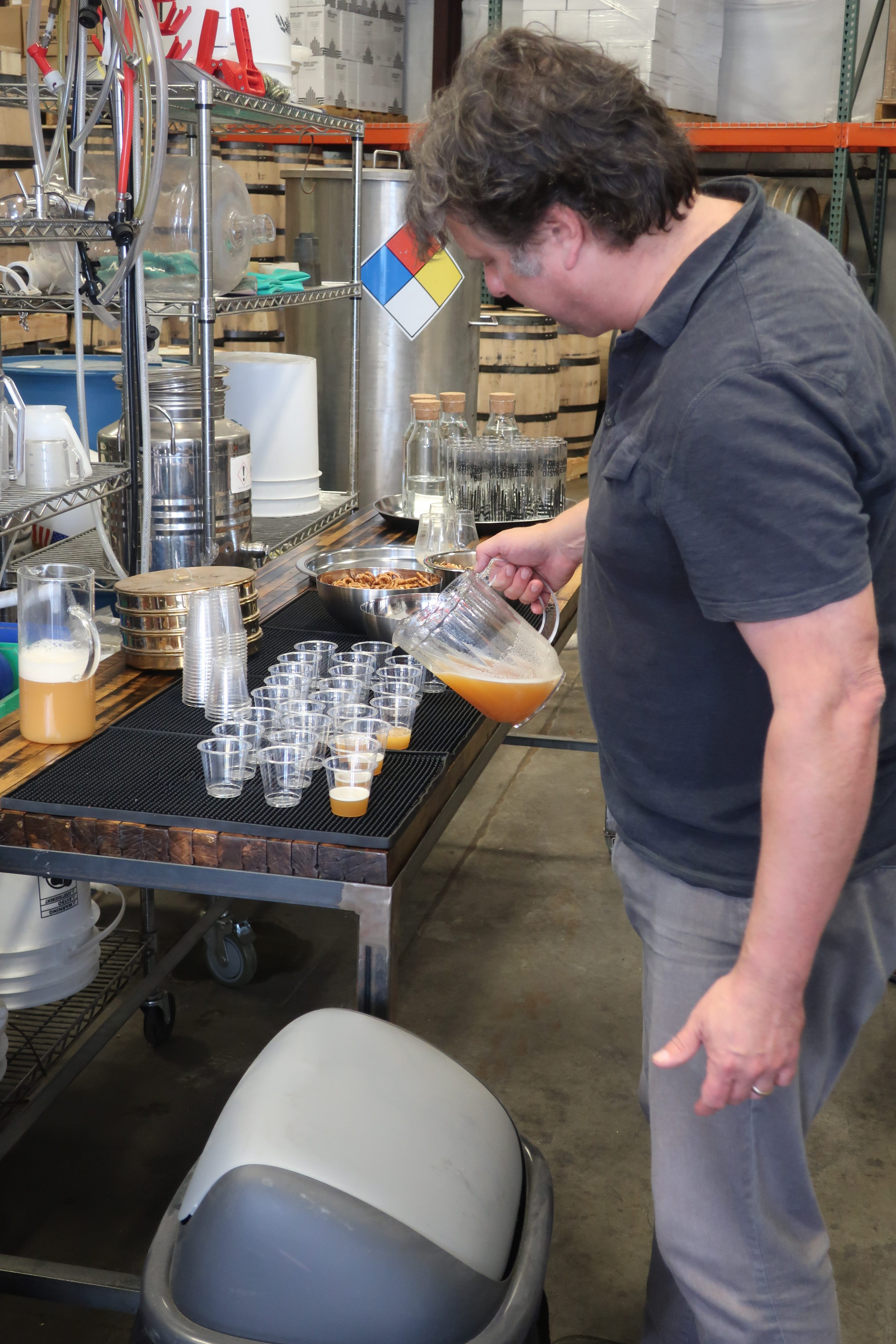 Christian Krogstad pouring freshly brewed wort prior to the distillation process in making Westward Whiskey.