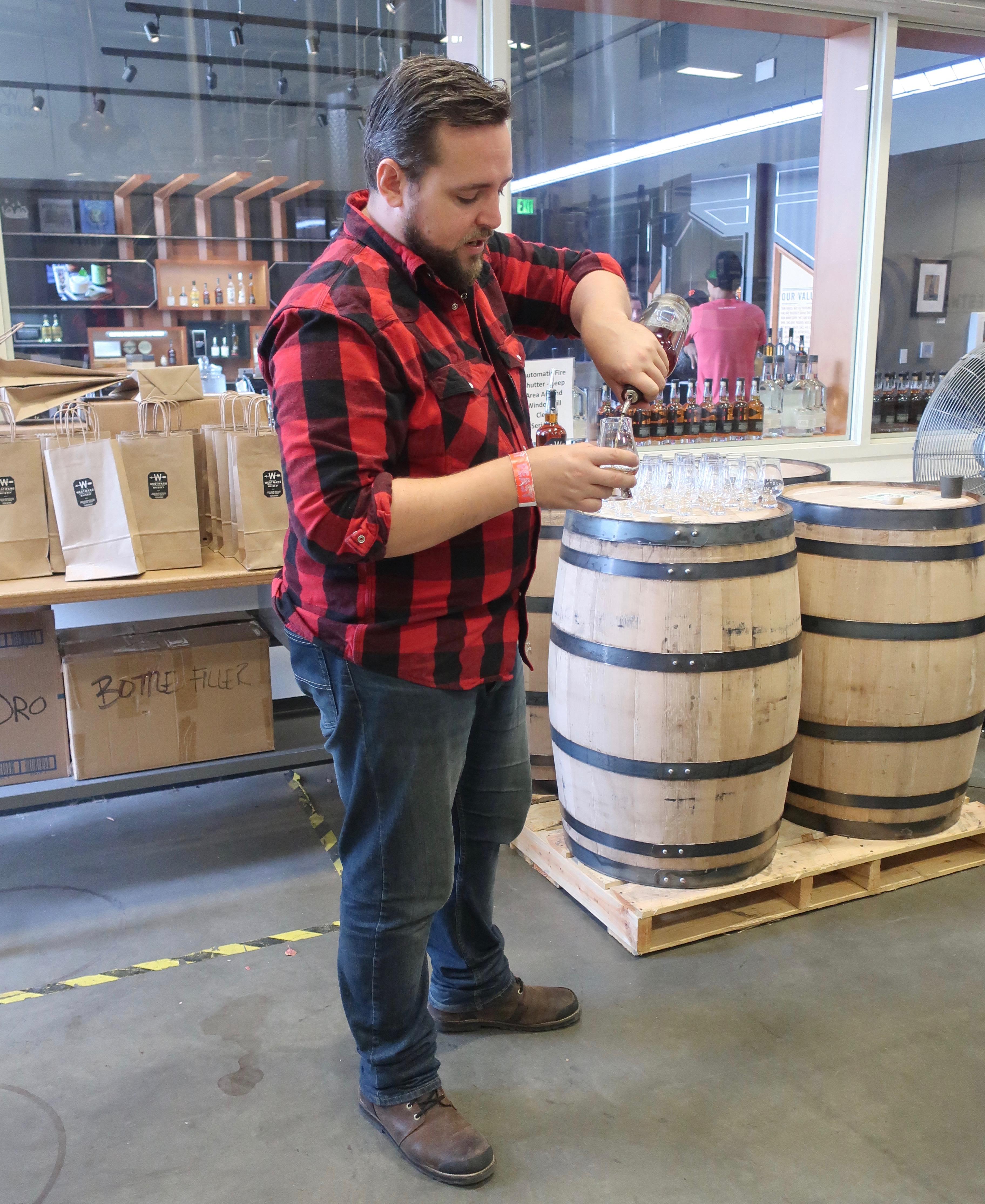 Jordan Felix pouring samples of a future Westward American Single Malt Whiskey.