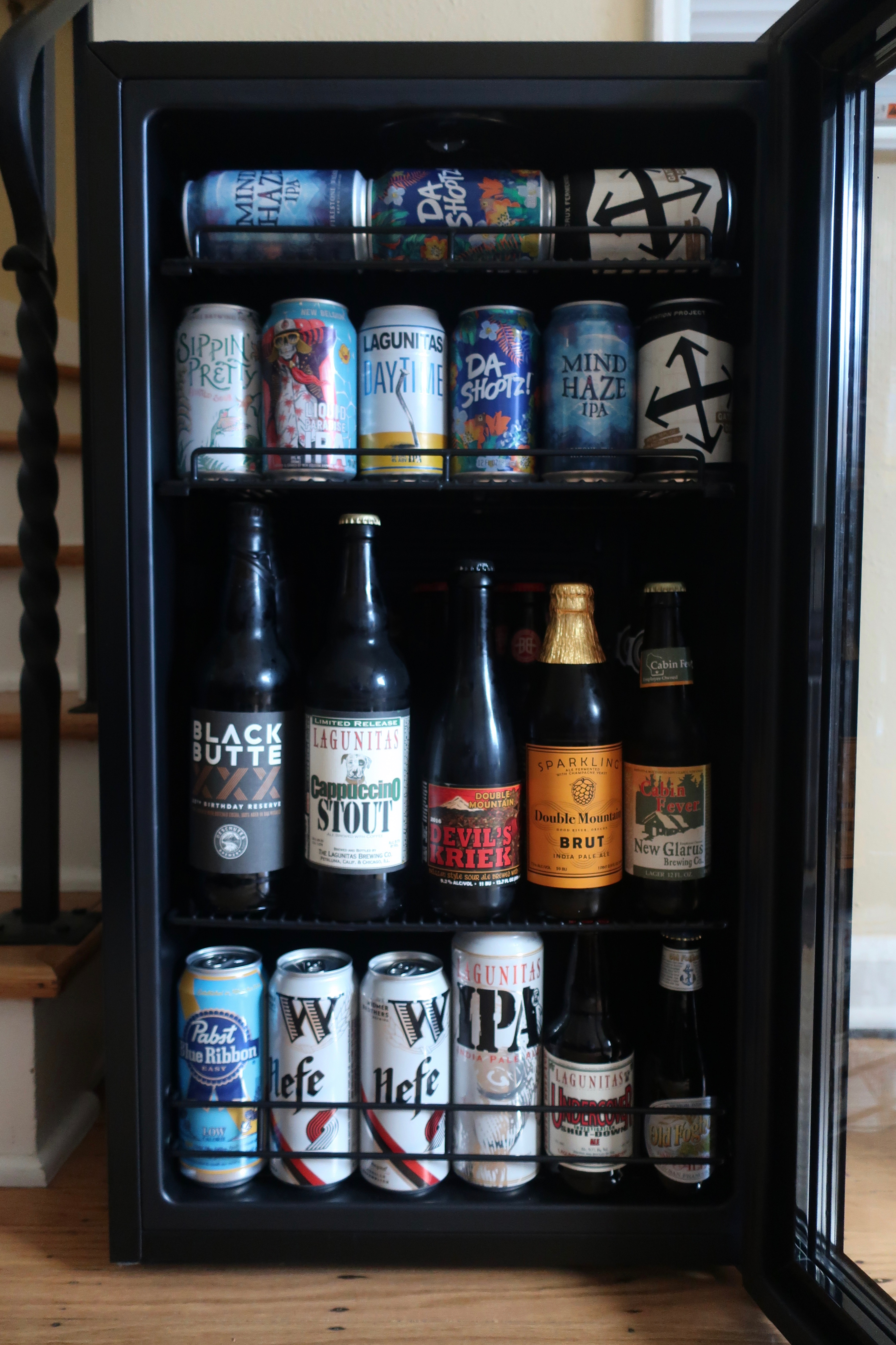 The NewAir Beers of the World Custom Beer Fridge holds all different sizes of beer cans and bottles.