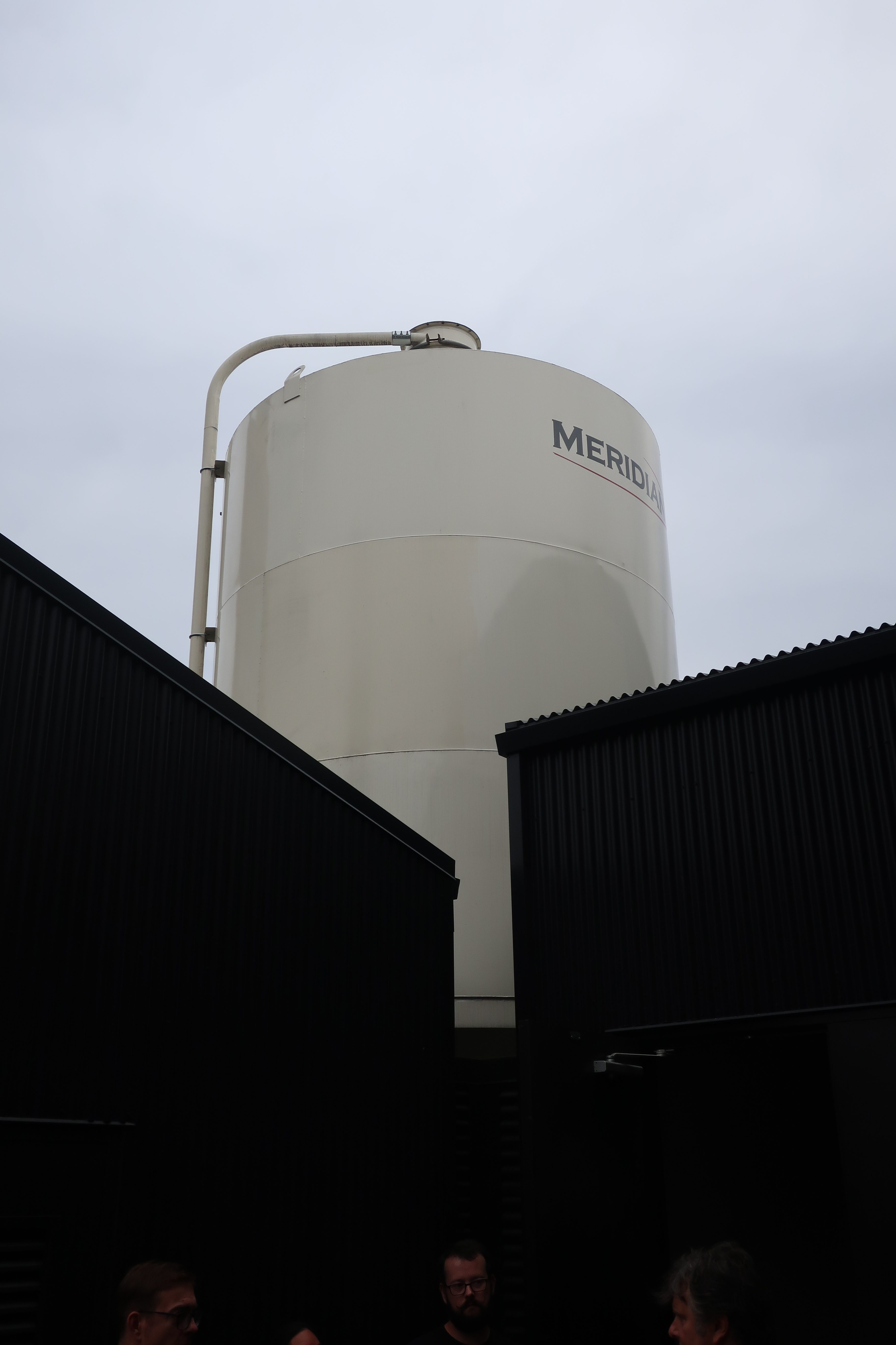 The grain silo looms over House Spirits that holds 75K pounds of malted barley to make Westward Whiskey.
