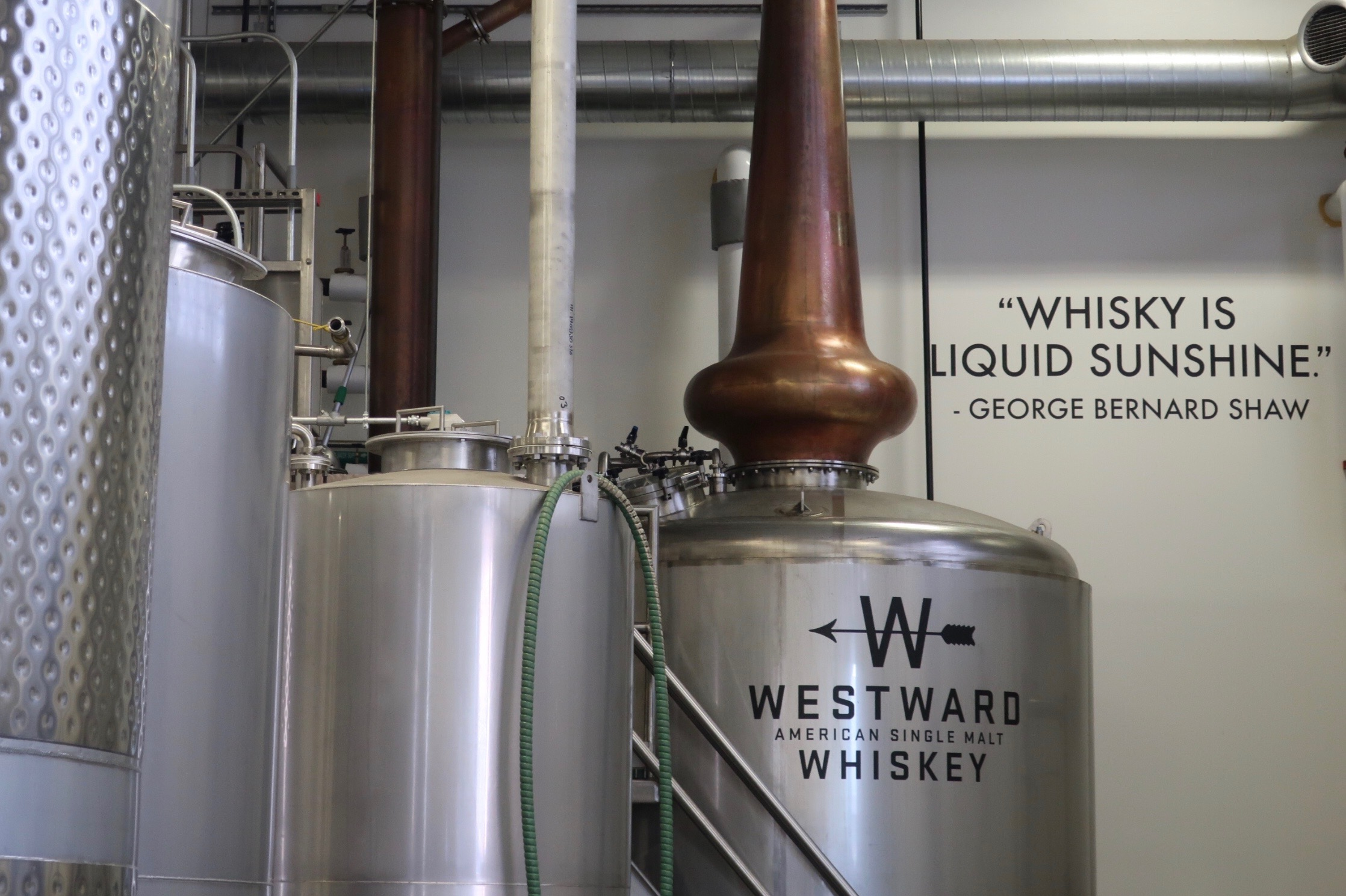 Whiskey Is Liquid Sunshine - George Bernard Shaw is on the wall inside House Spirits, the home of Westward Whiskey.