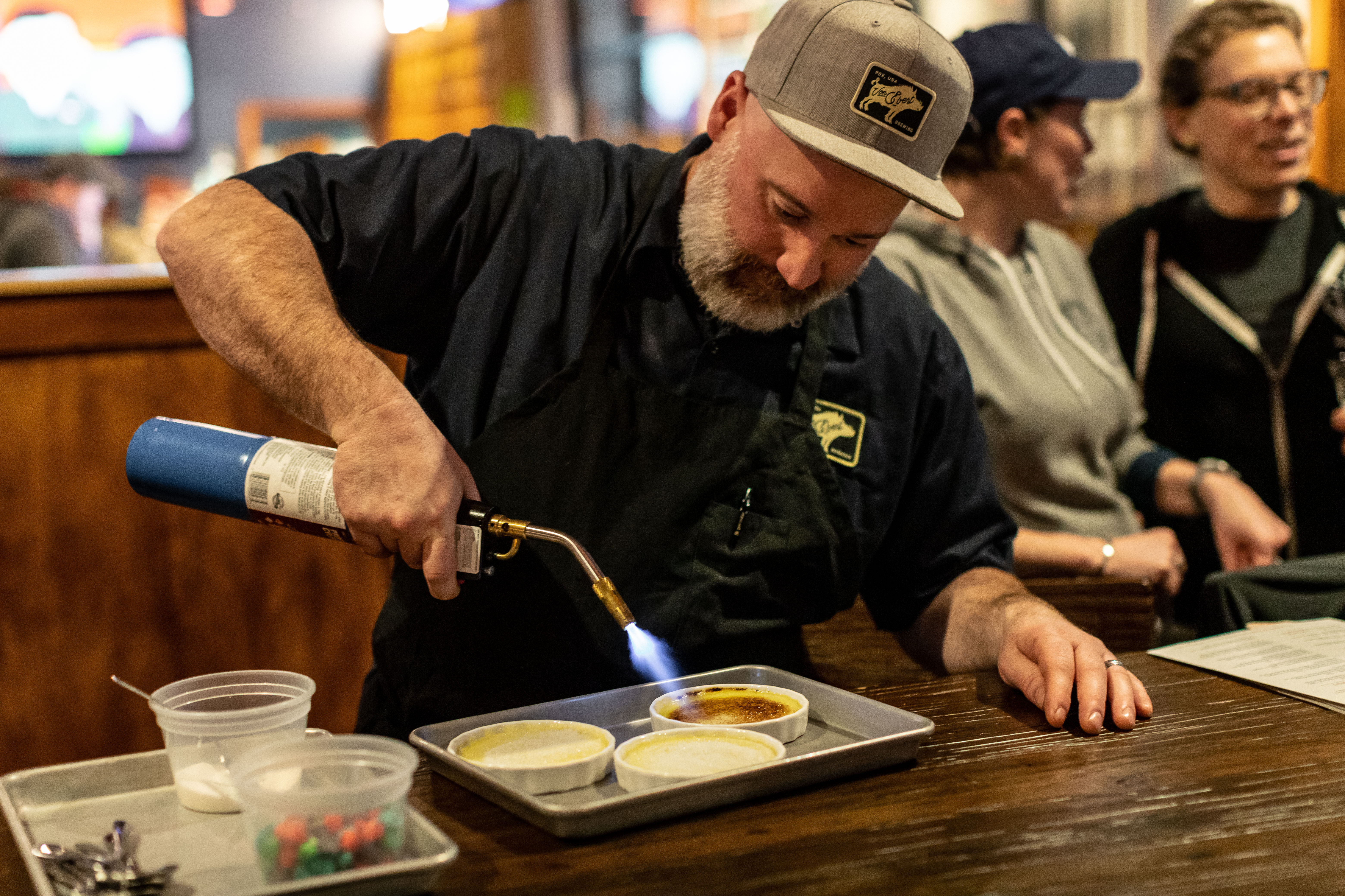 Executive Chef Jackson Wyatt uses a torch. (image courtesy of Von Ebert Brewing)