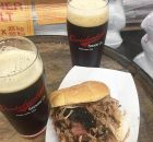 image of pork sanwich and Barrel-Aged Lucubrator courtesy of Occidental Brewing