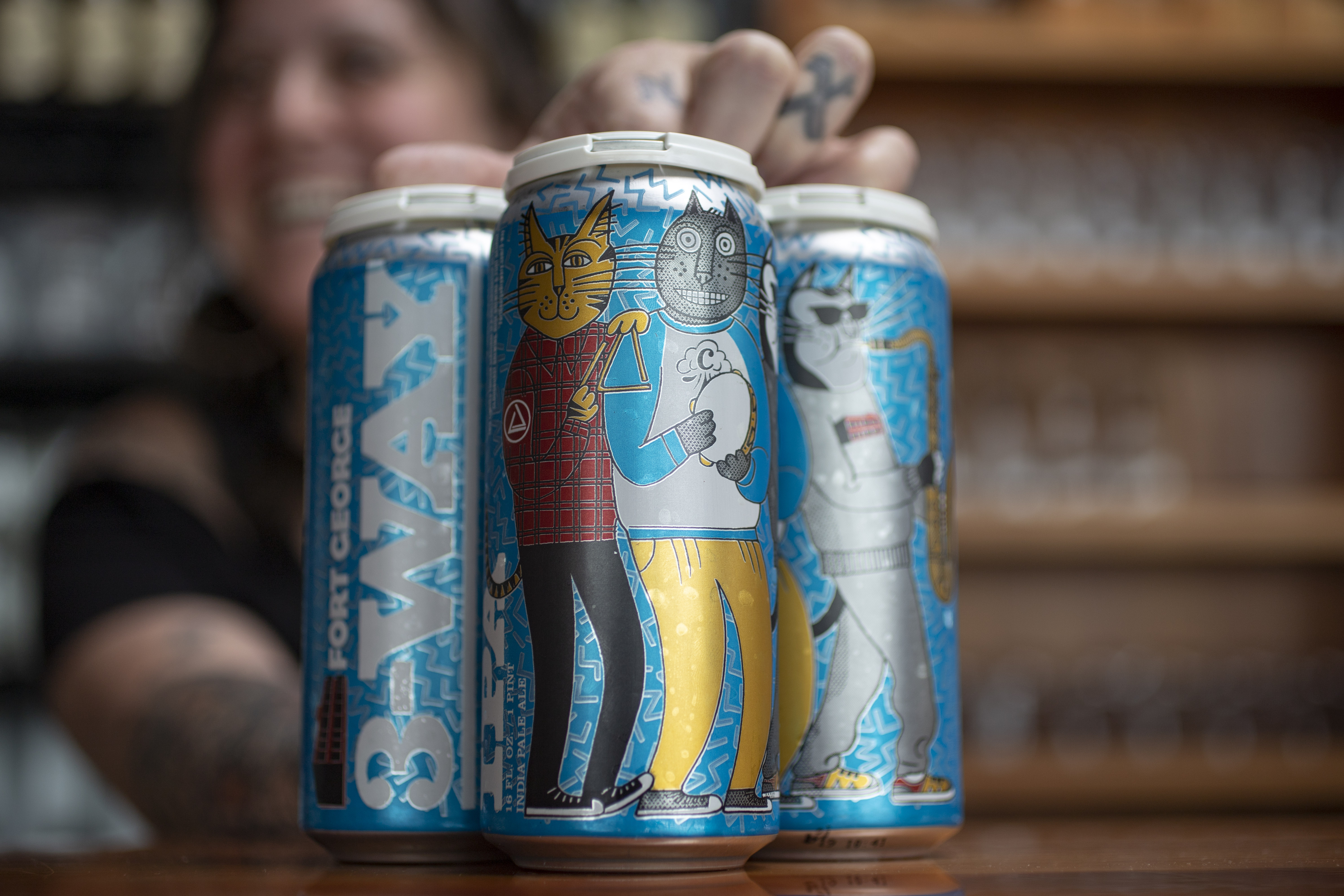 Cans of 2019 3-Way IPA Release with Fort George Brewery + Ruse Brewing + Cloudburst Brewing. (image courtesy of Fort George Brewery)