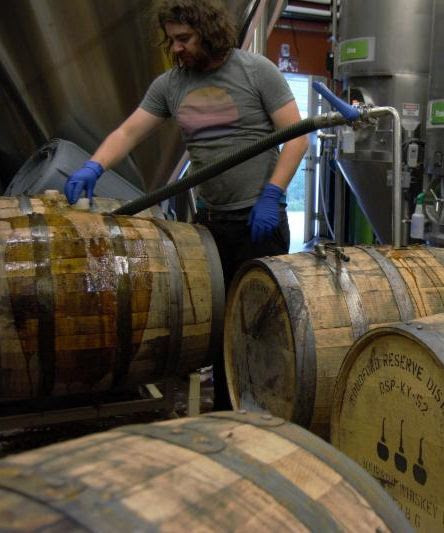 Oakshire's Director of Brewing Operations, Dan Russo filling former whiskey barrels. (image courtesy of Oakshire Brewing)