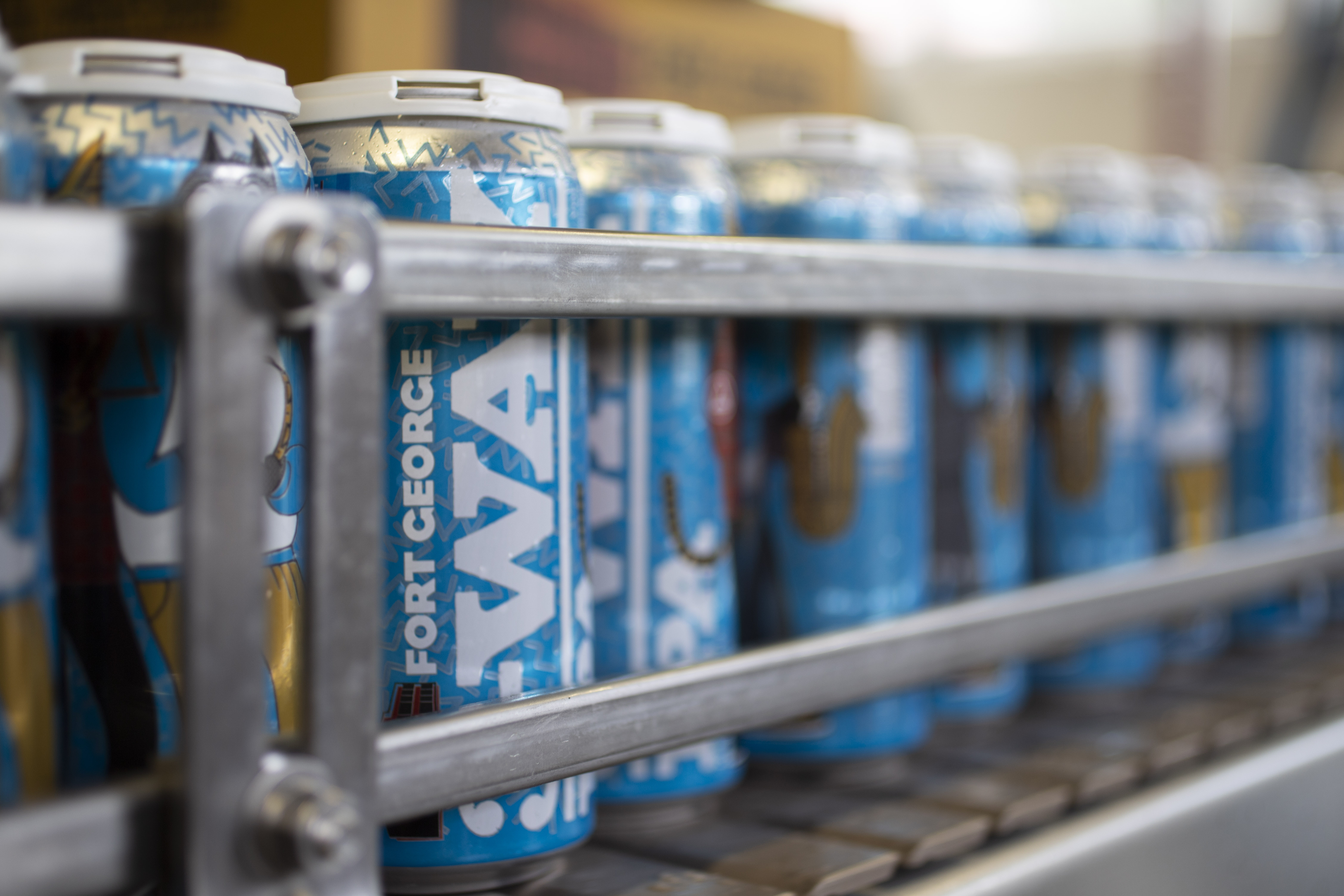 On the canning line with the 2019 3-Way IPA from Fort George Brewery + Ruse Brewing + Cloudburst Brewing. (image courtesy of Fort George Brewery)