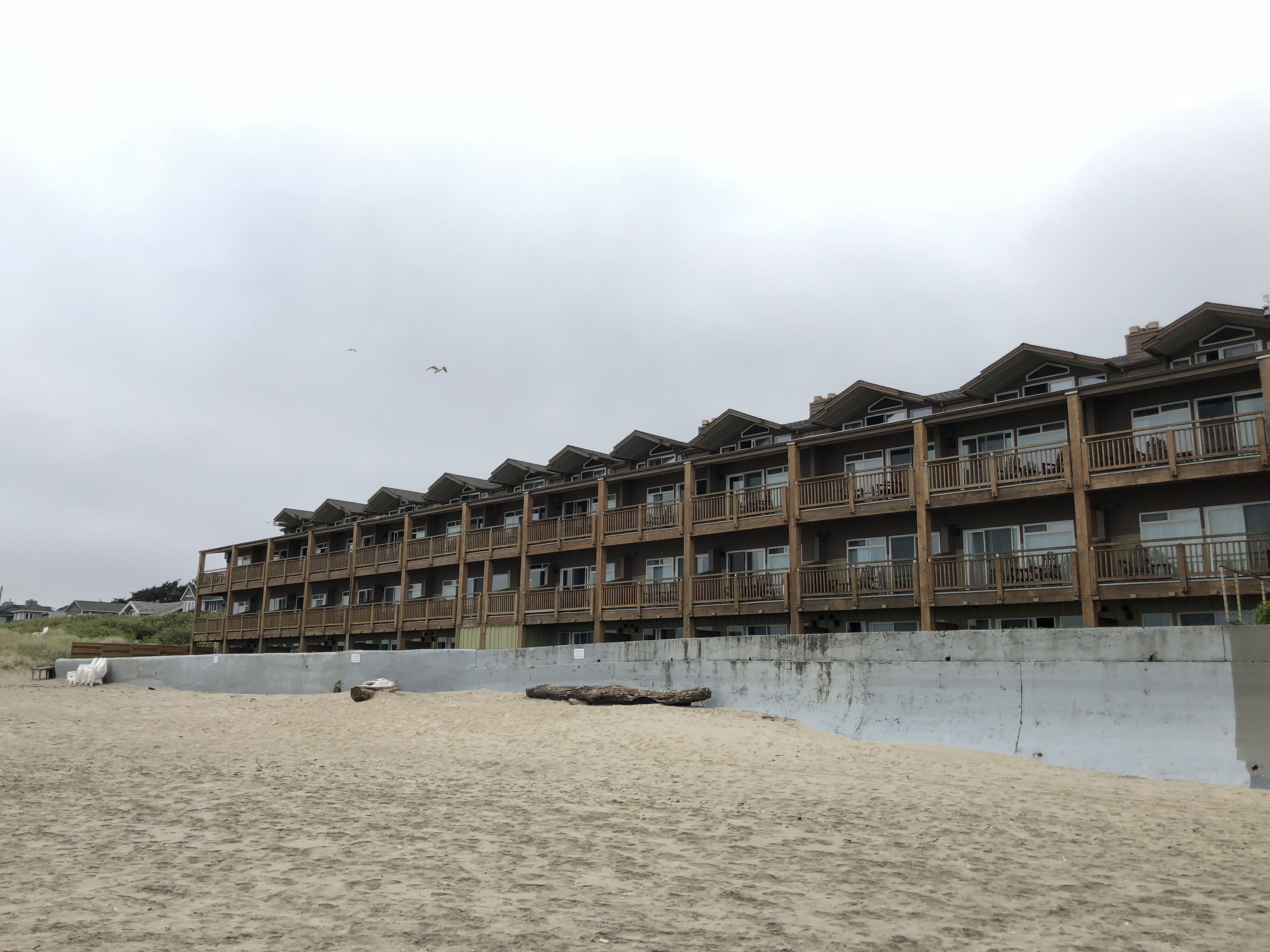 The view of Surfsand Resort in Cannon Beach, Oregon from the beach.