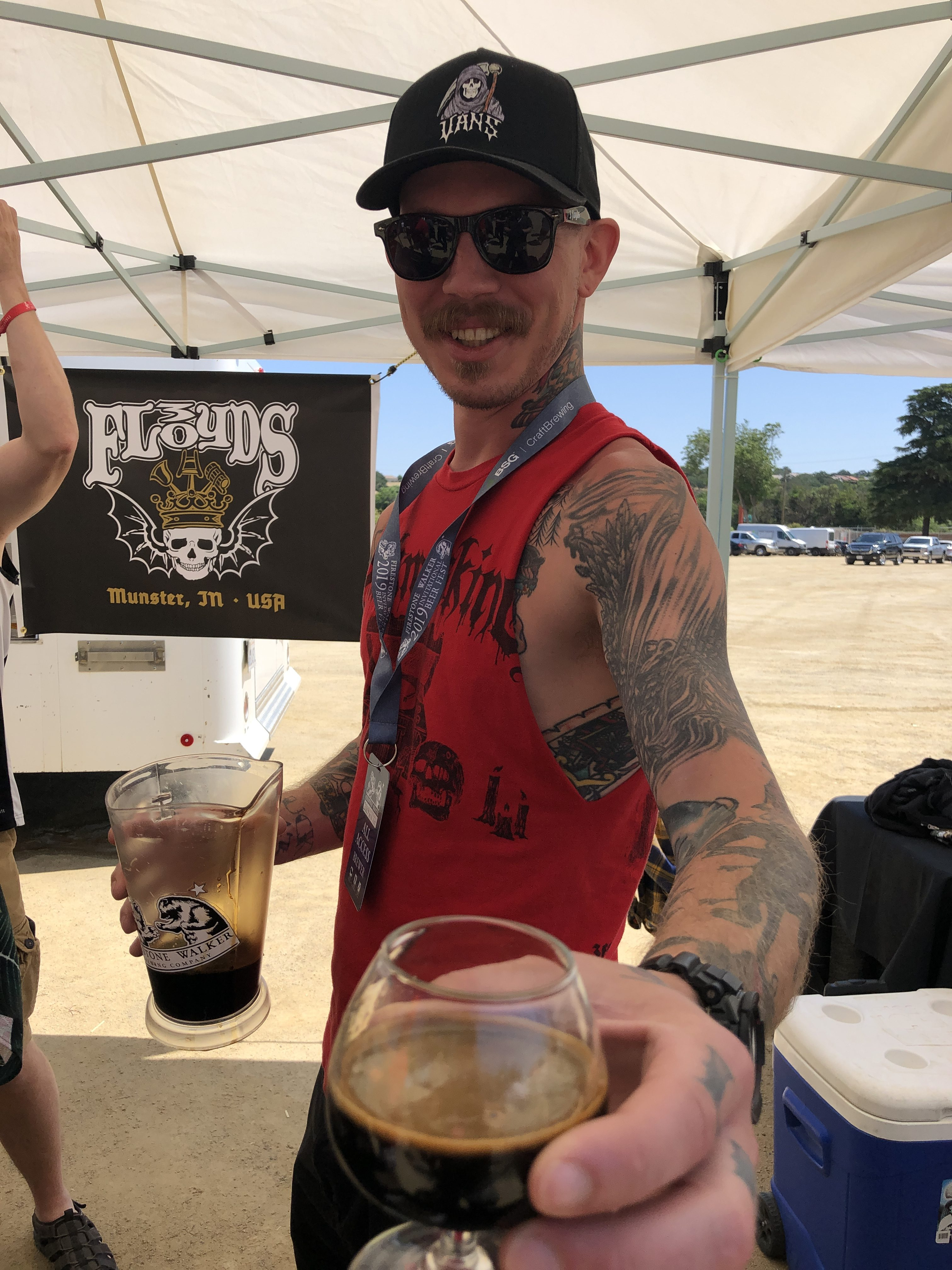 Being served a Dark Lord from 3 Floyds Brewing at the 2019 Firestone Walker Invitational Beer Fest.