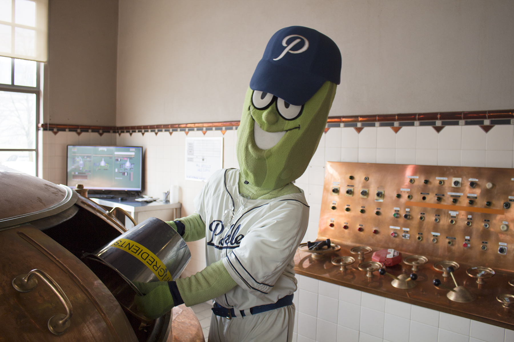 Dillon The Pickle assisting in brewing Dill's Pils. (image courtesy of Portland Brewing)
