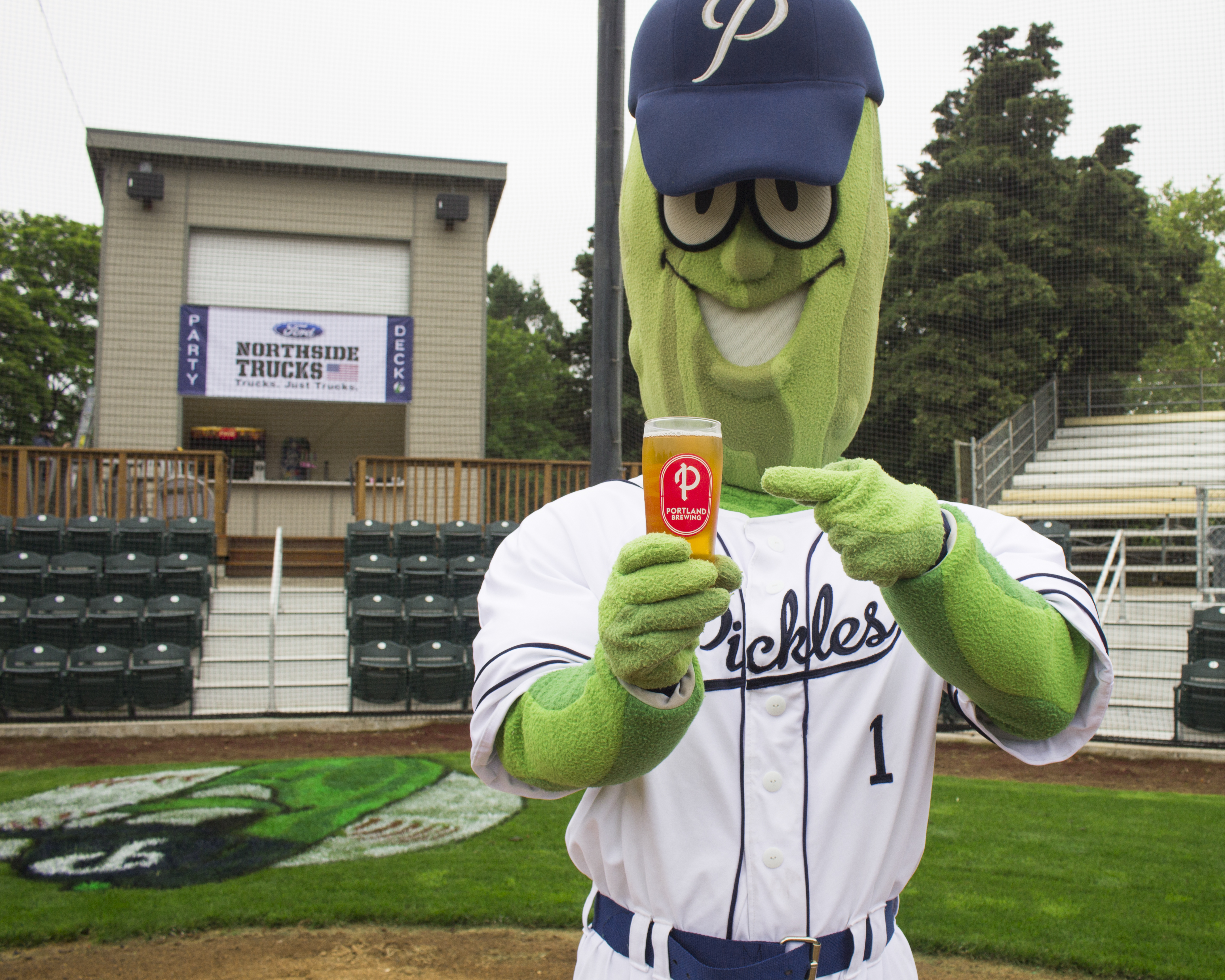 Dillon The Pickle cheers to game day. (image courtesy of Portland Brewing)