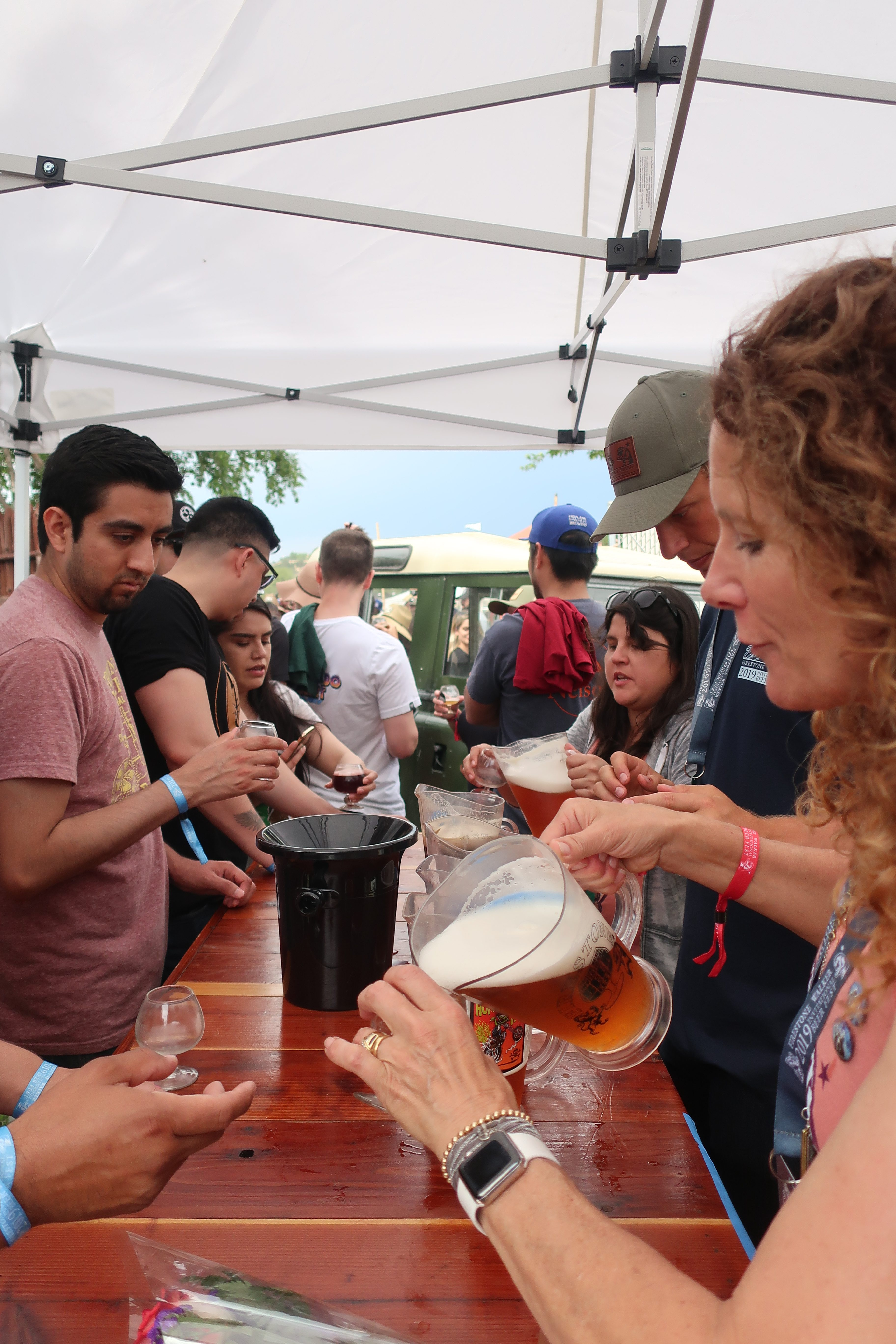 Polly Walker pouring beers at the Firestone Barrelworks booth during the 2019 Firestone Walker Invitational Beer Fest.