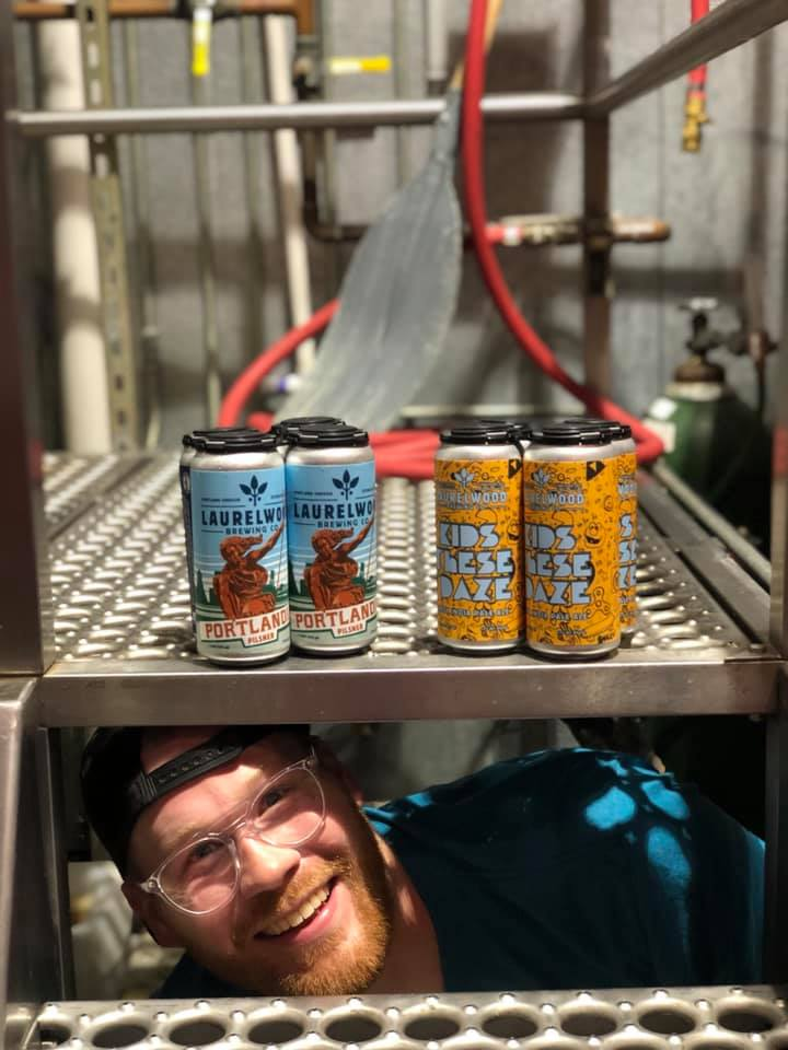 Cans of Kids These Daze Hazy IPA and Portlandia Pilsner. (image courtesy of Laurelwood Brewing)