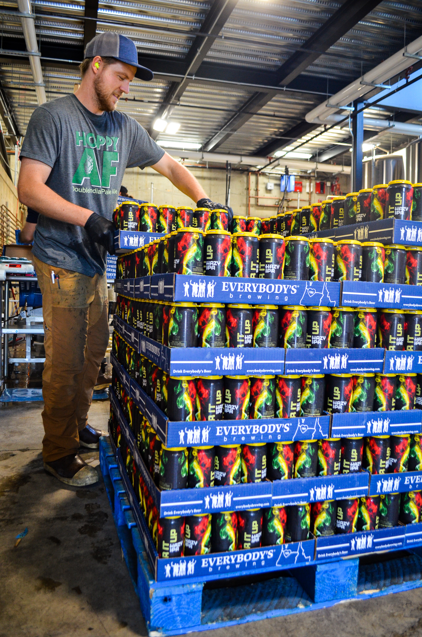 Josh Billings loading up the first pallet of Stir it Up Hazy IPA. (image courtesy of Everybody's Brewing)