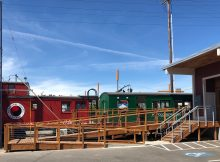 Two train cars offer seating options at Mt. Hood Brewing Tilikum Station.