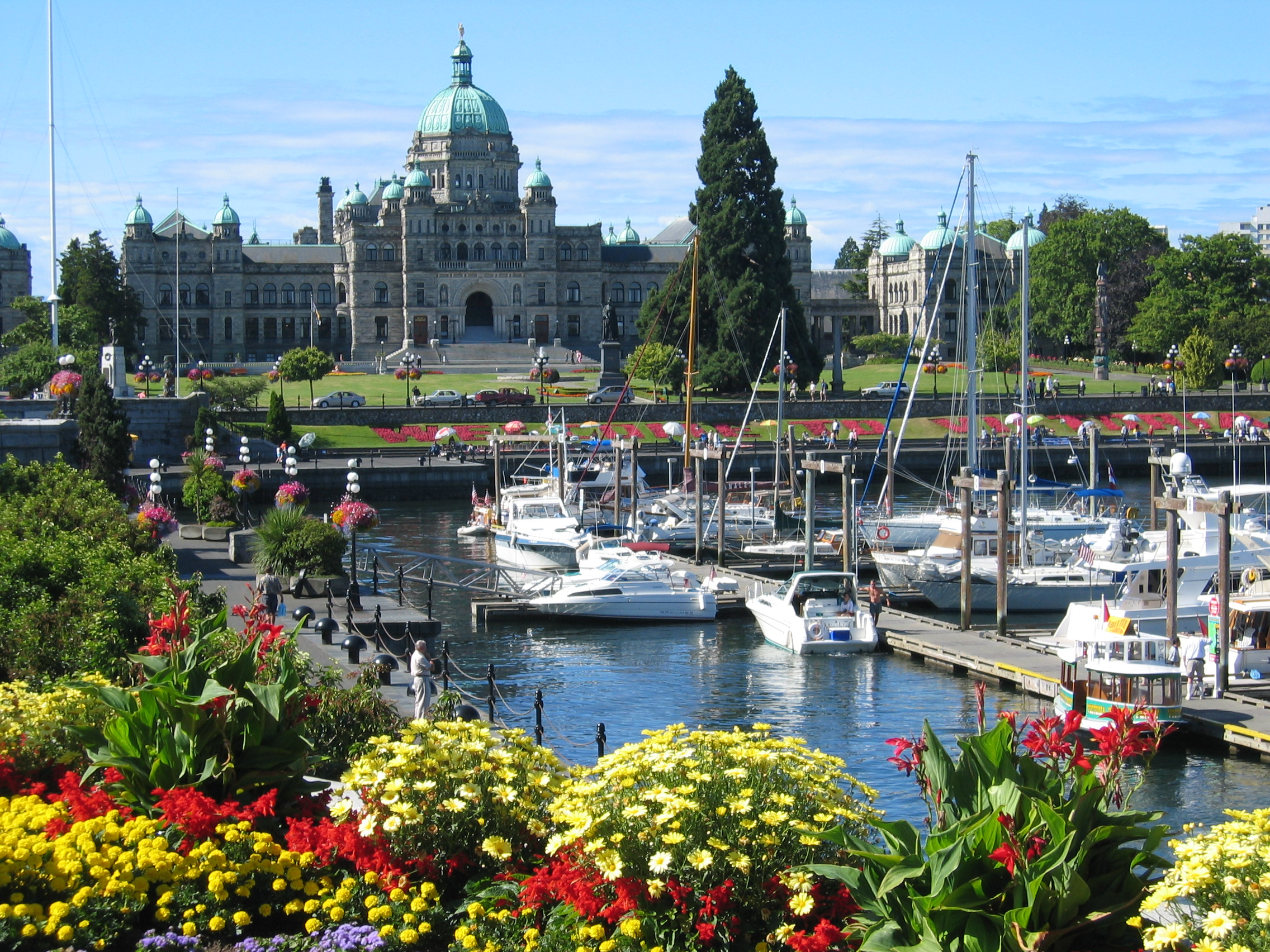 A view of the the harbor with the capitol building in the background in Victoria, BC